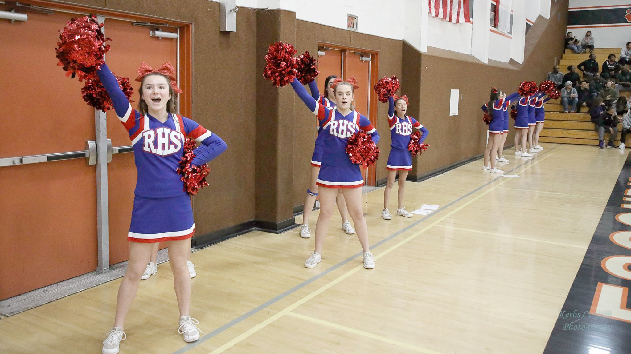 Ramona High cheerleaders rally players and fans.