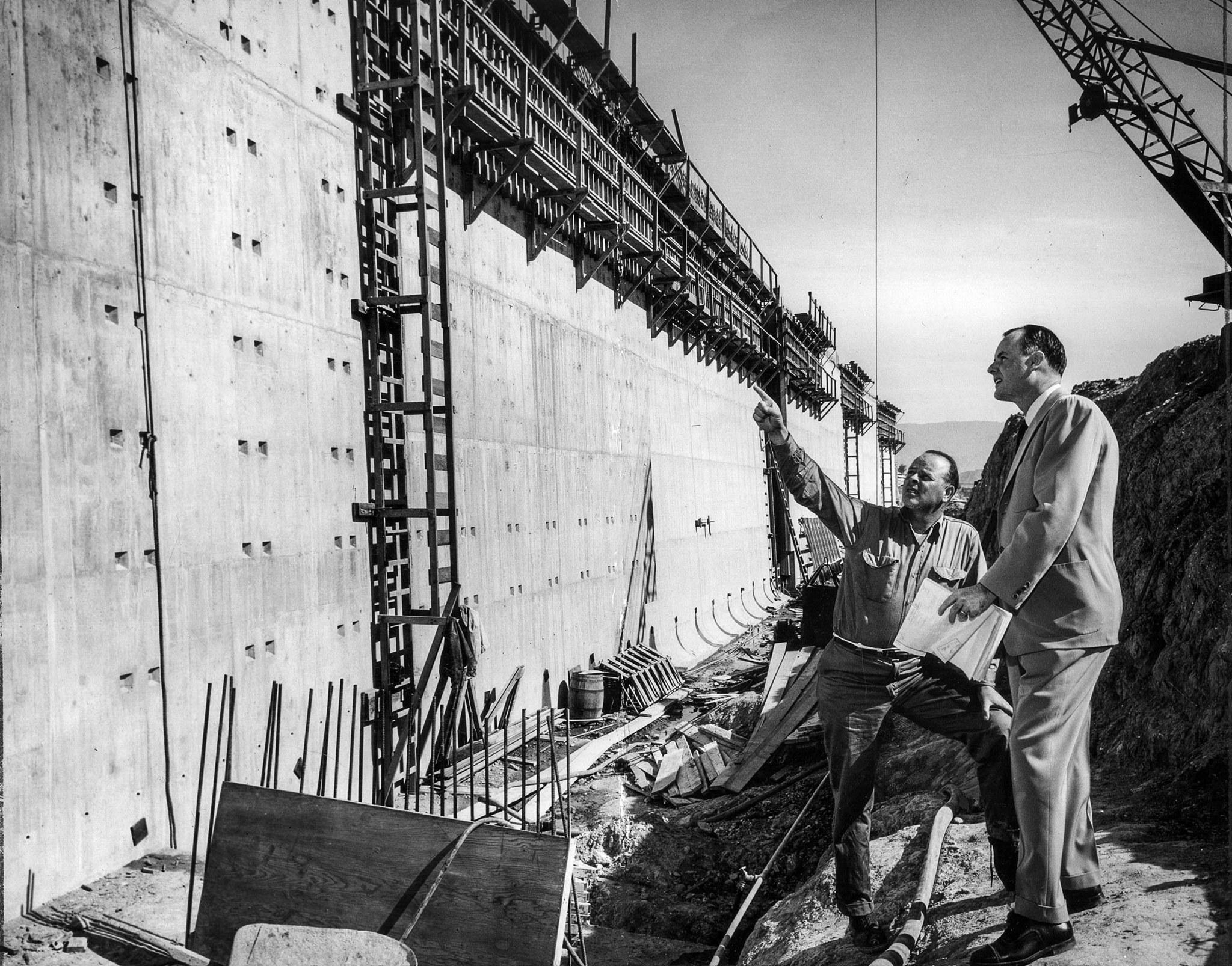 March 10, 1954: Contractor M. J. Brock Jr., left, and Superintendent Bill Lassetter check the progre