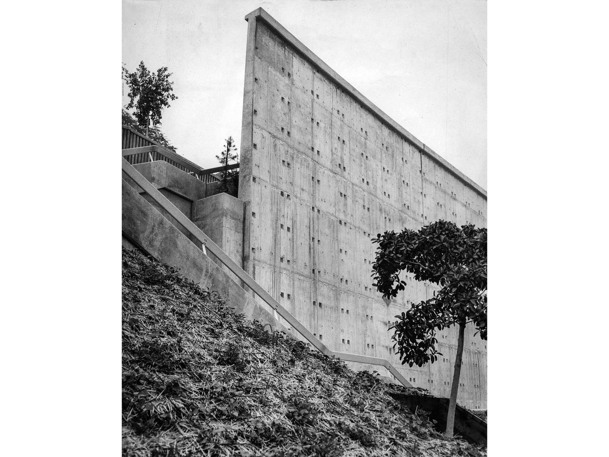 Dec. 16, 1955: Barren wall of Ft. Moore Pioneer Memorial then under construction on Hill St. next to