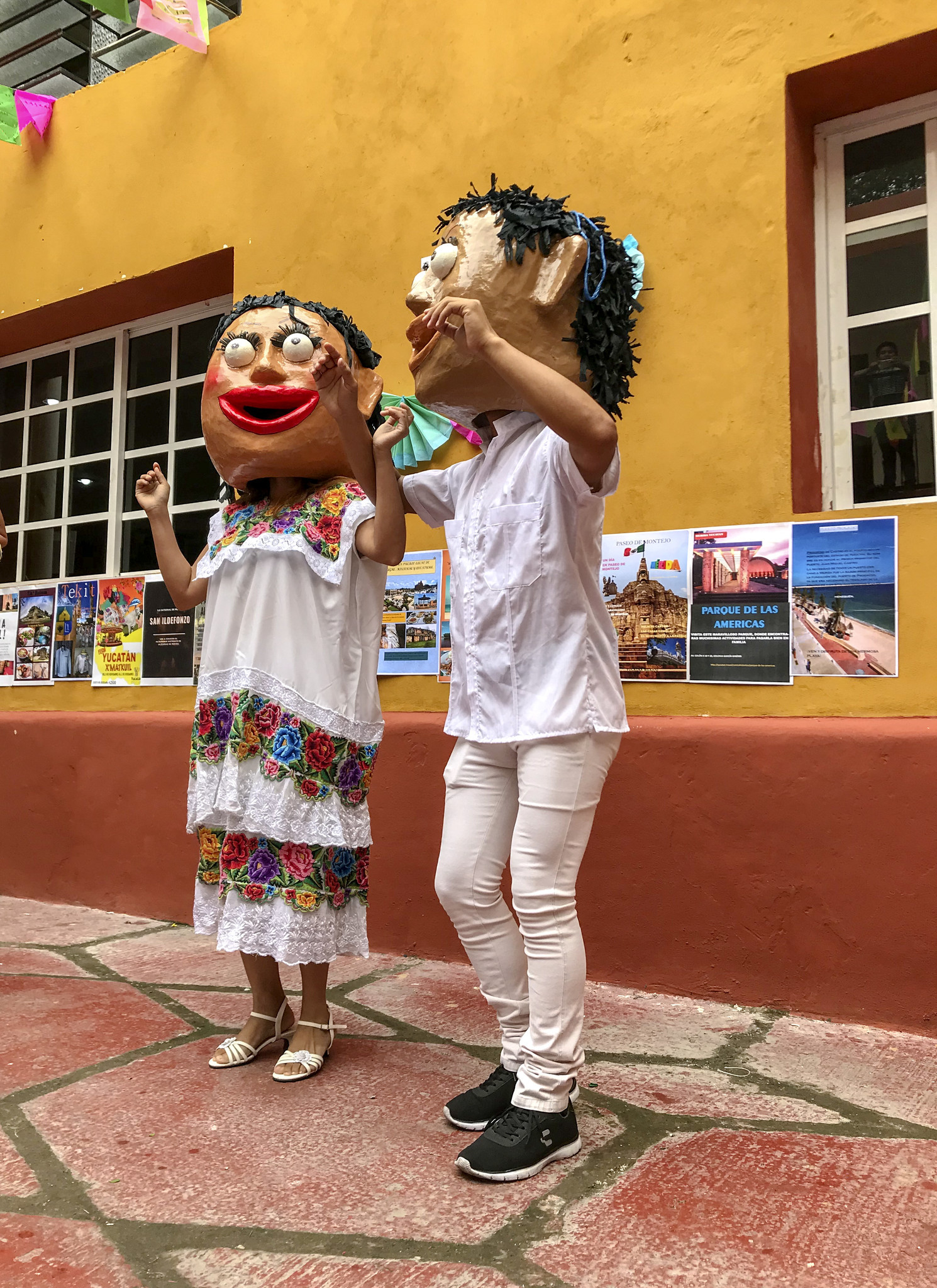 "MERIDA, MEXICO - Two traditional dancing ""dolls"" at a festival in a Merida cultural center."