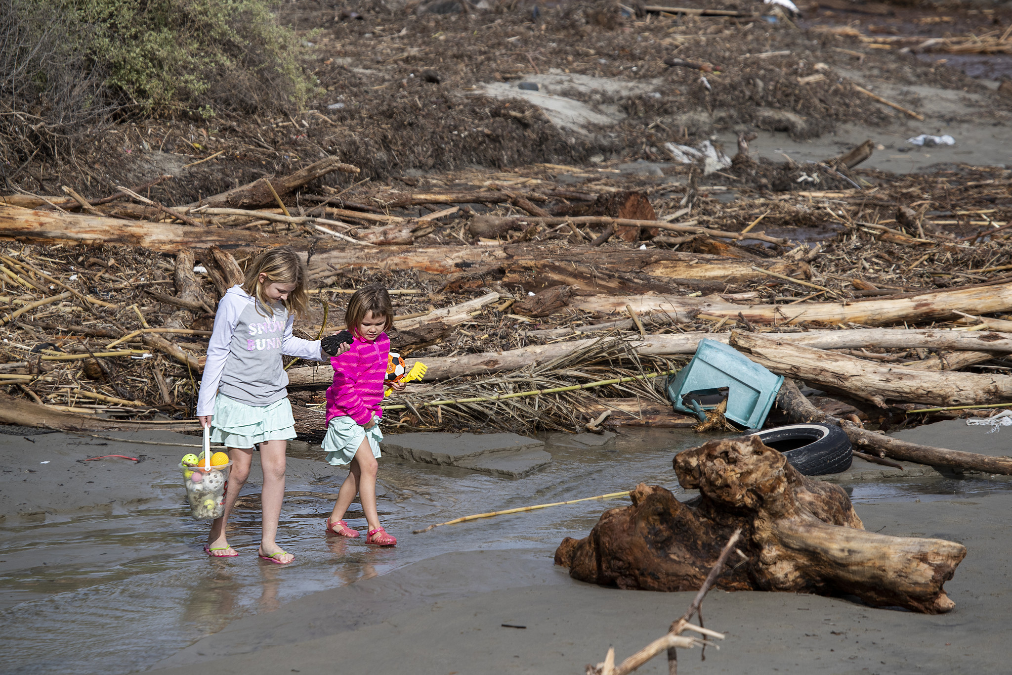 DANA POINT, CALIF. -- FRIDAY, FEBRUARY 15, 2019: Kids gather treasures as they search among storm de
