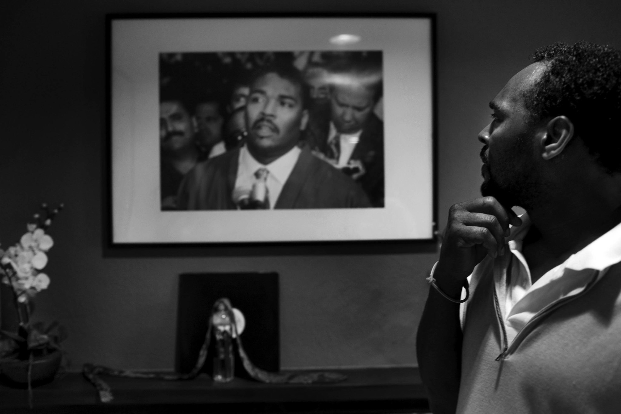 March 26, 2012: Rodney Glen King looks at a picture of himself from May 1, 1992, the third day of th