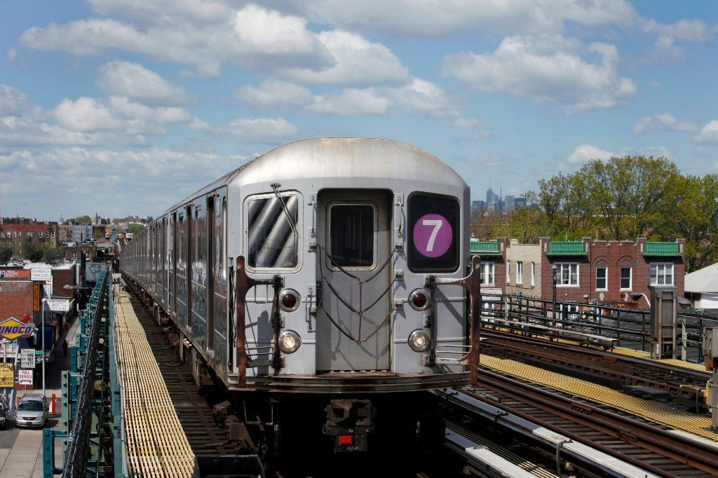 Man retrieving cellphone from NYC subway tracks run over by train, miraculously survives