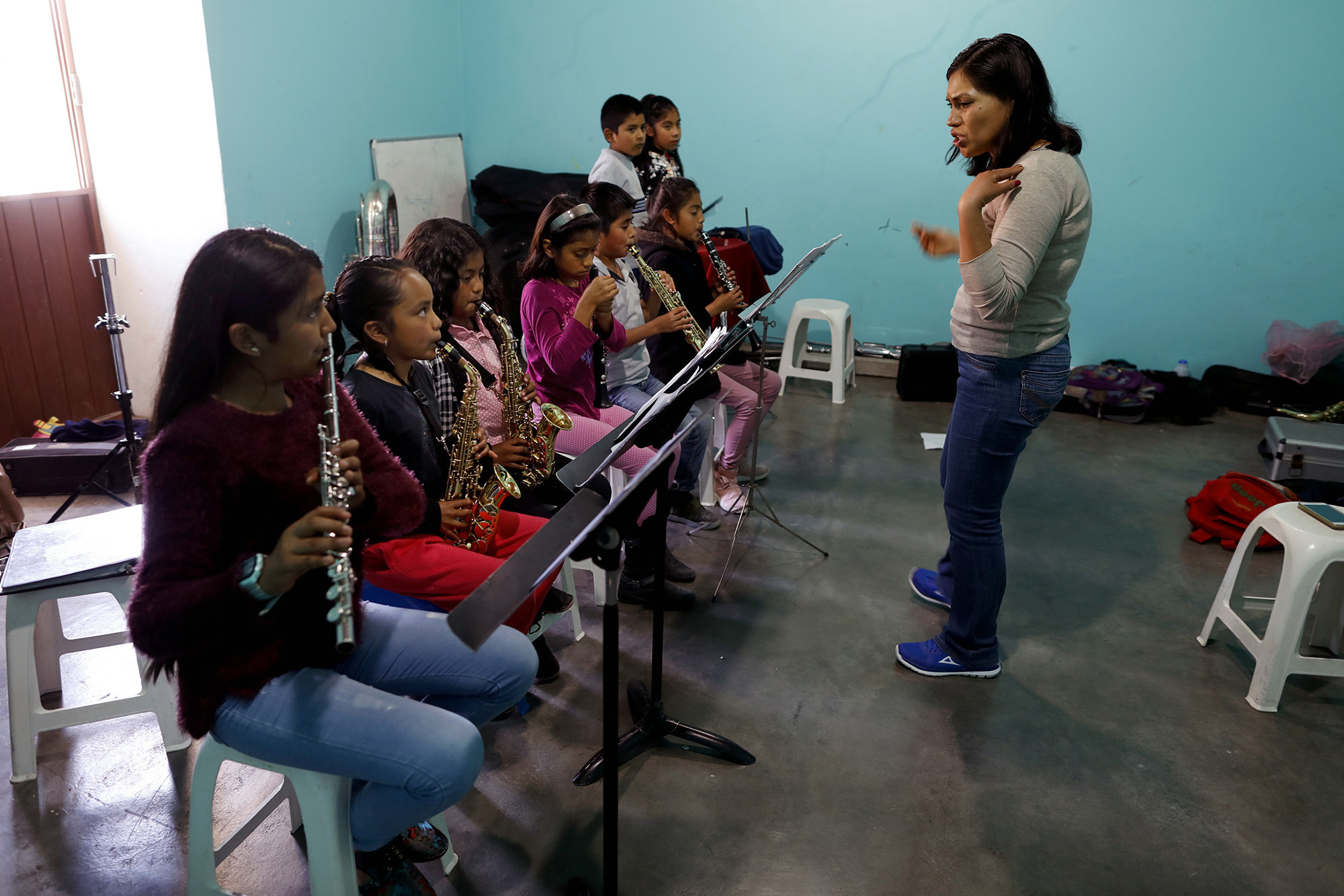 TLAXIACO, OAXACA — MONDAY, FEBRUARY 4, 2019: Guadalupe Ramirez, right, gives music lessons to stude