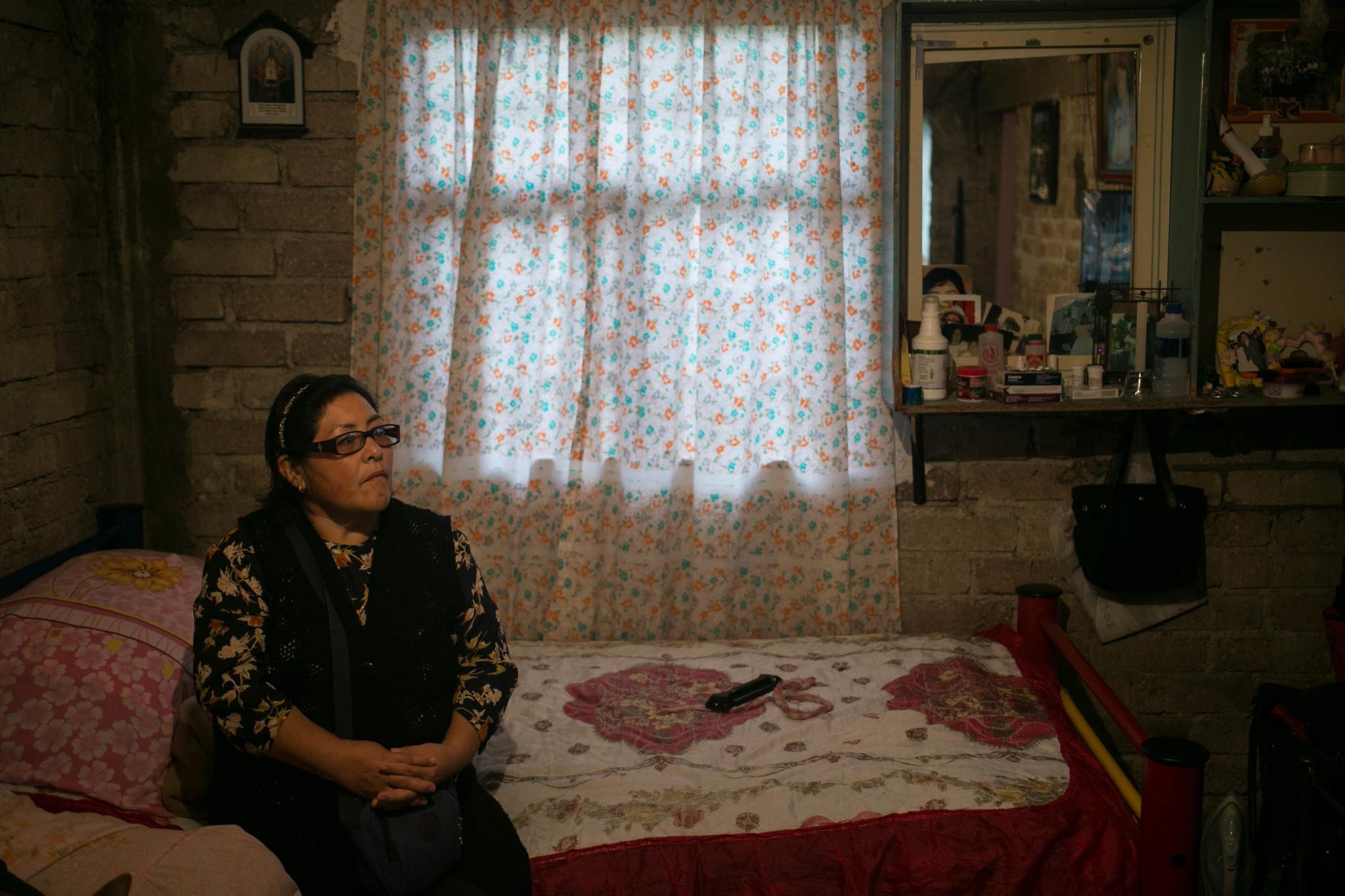 Cecilia Rebeca Chavez, 53, sits in her home in Nicolas Romero, Estado de Mexico, Mexico.
