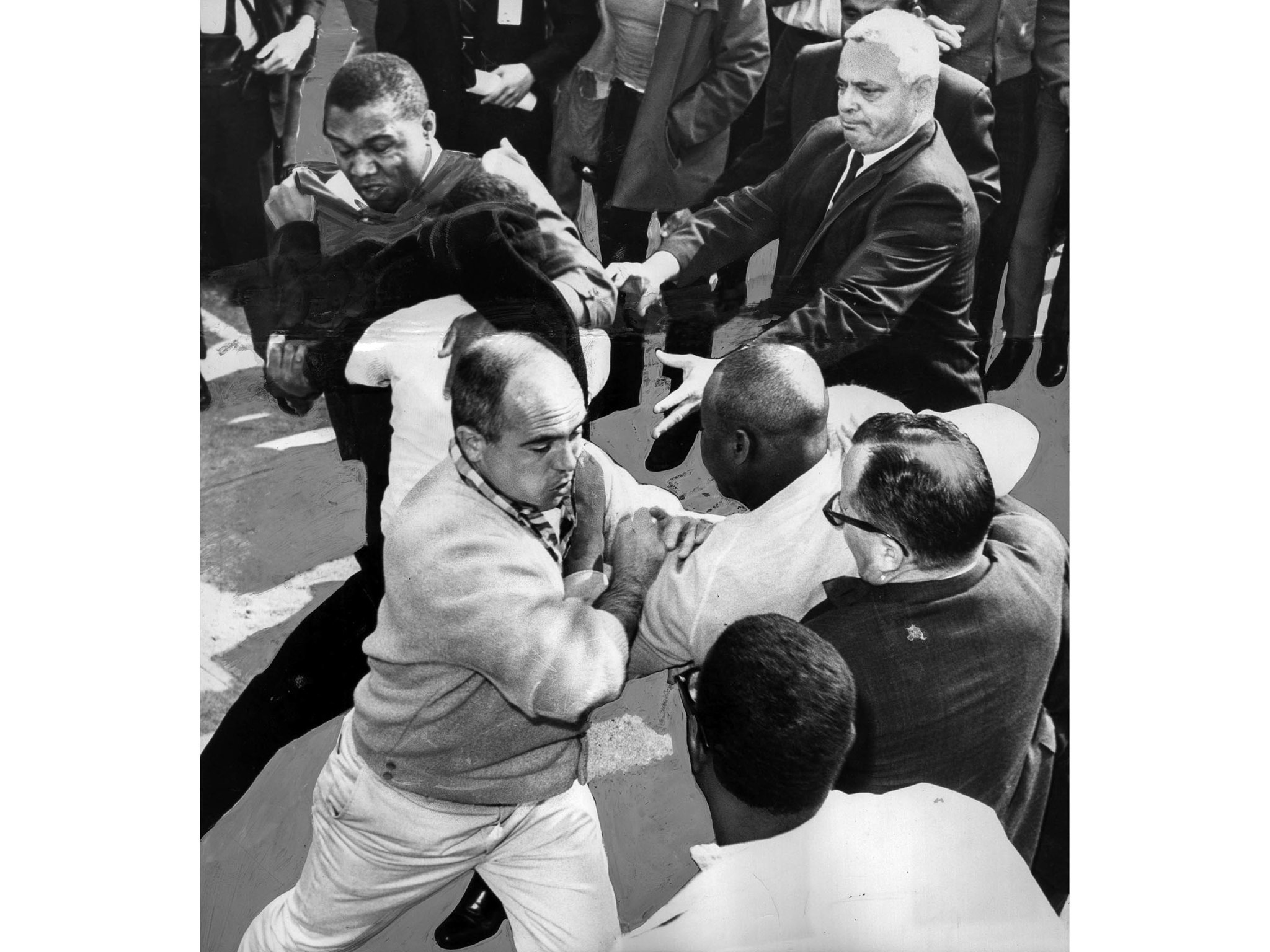 March 10, 1965: A U.S. Marshal, upper left, another with checkered shirt, lower left, and third in s