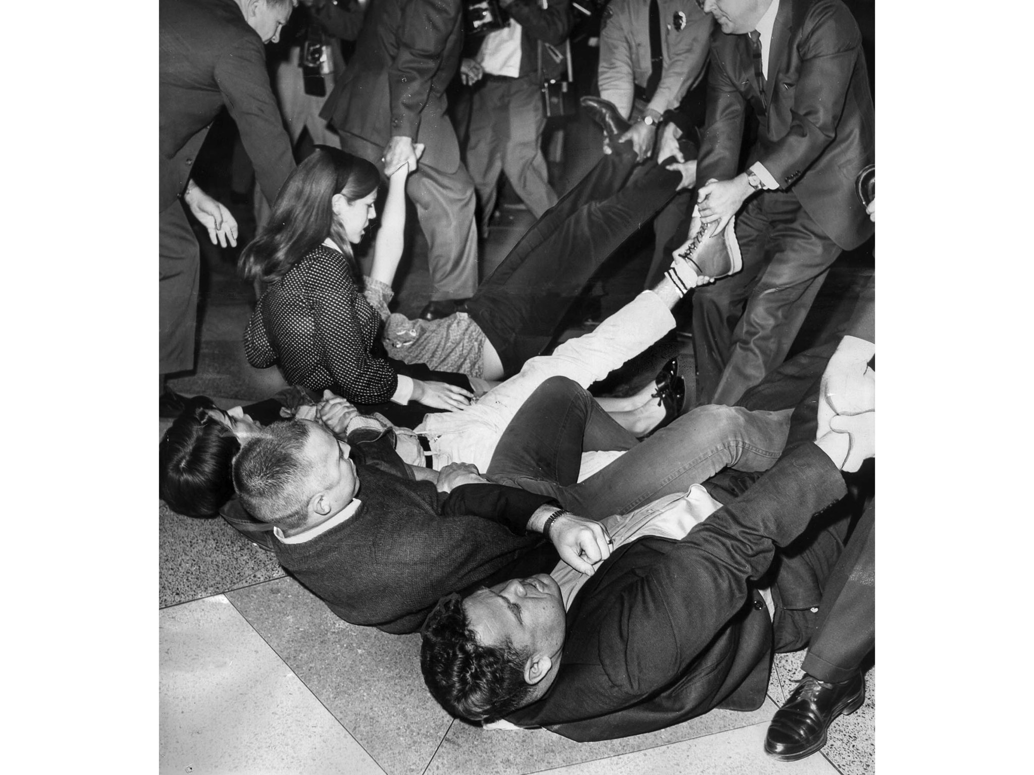 March 9, 1965: U.S. marshals drag sit-down demonstrators during melee in the lobby of the Federal Bu