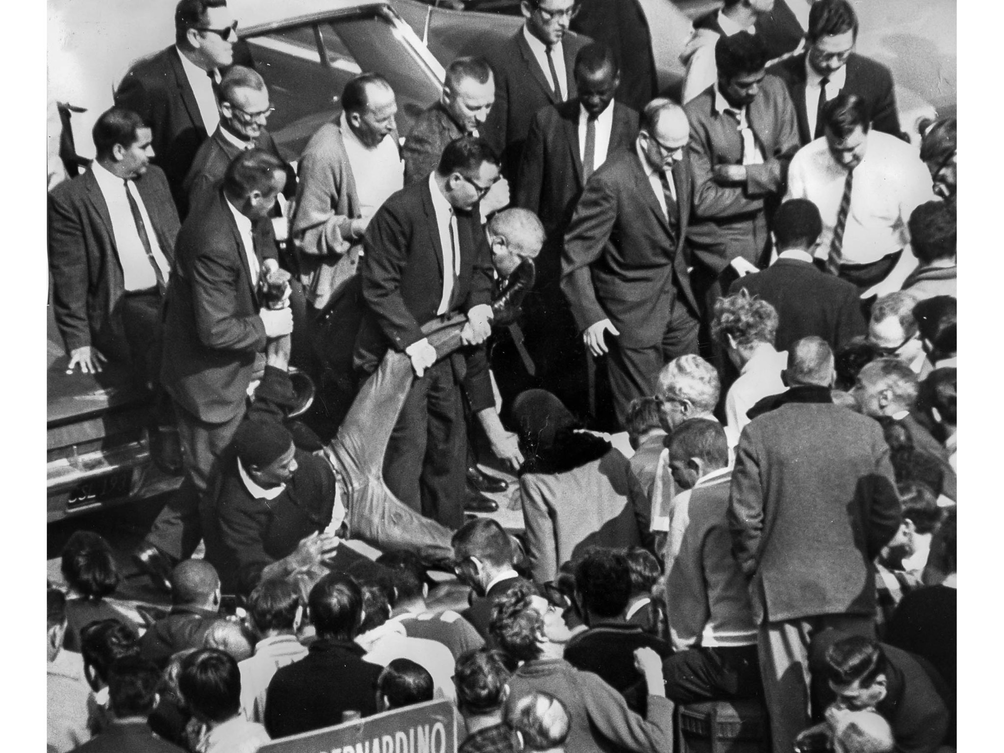 March 10, 1965: One of the sit-in demonstrators is lifted by an arm and leg as he is removed from pa