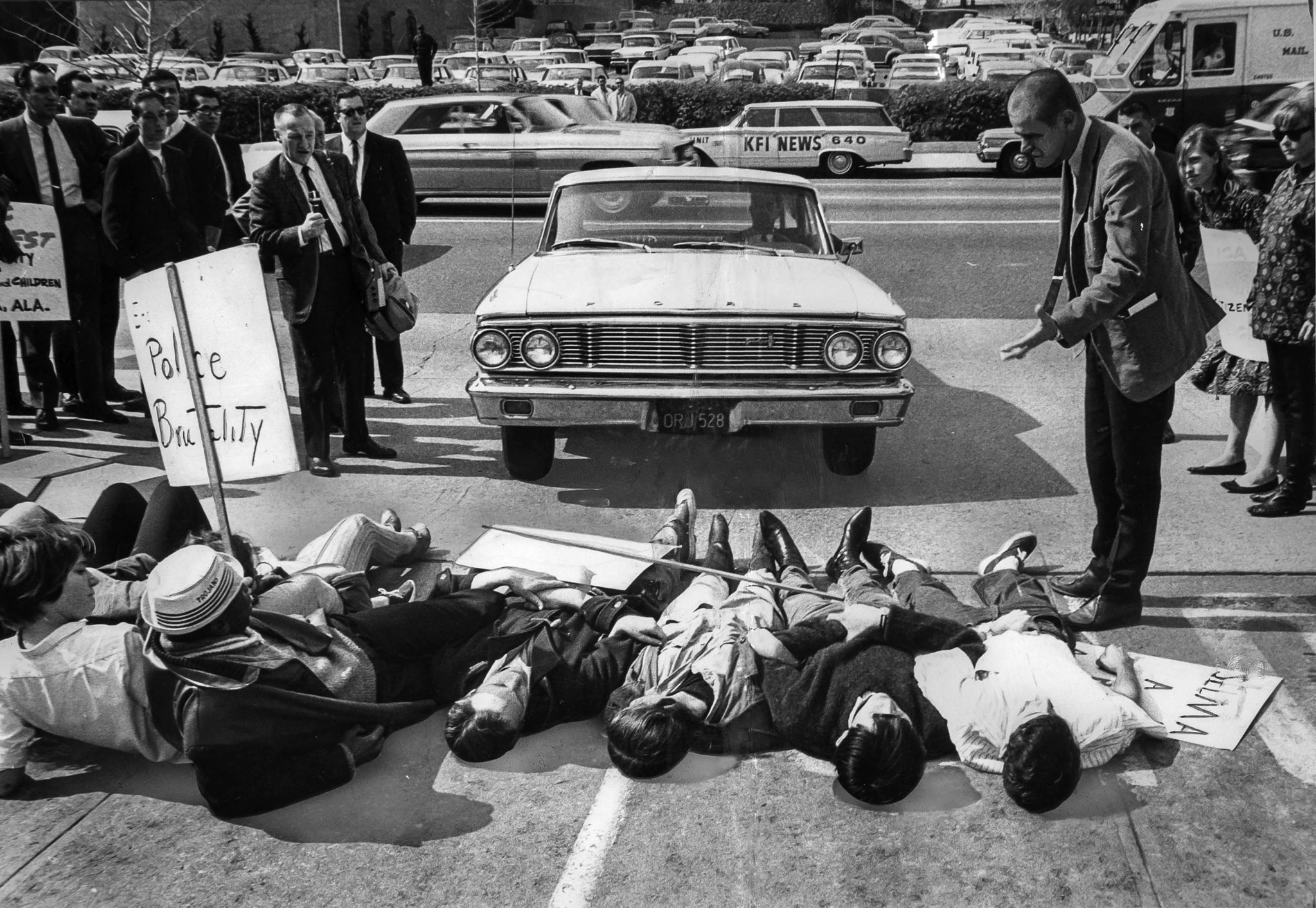 March 10, 1965: Deputy U.S. marshal, right, lays down the law to group of demonstrators lying across