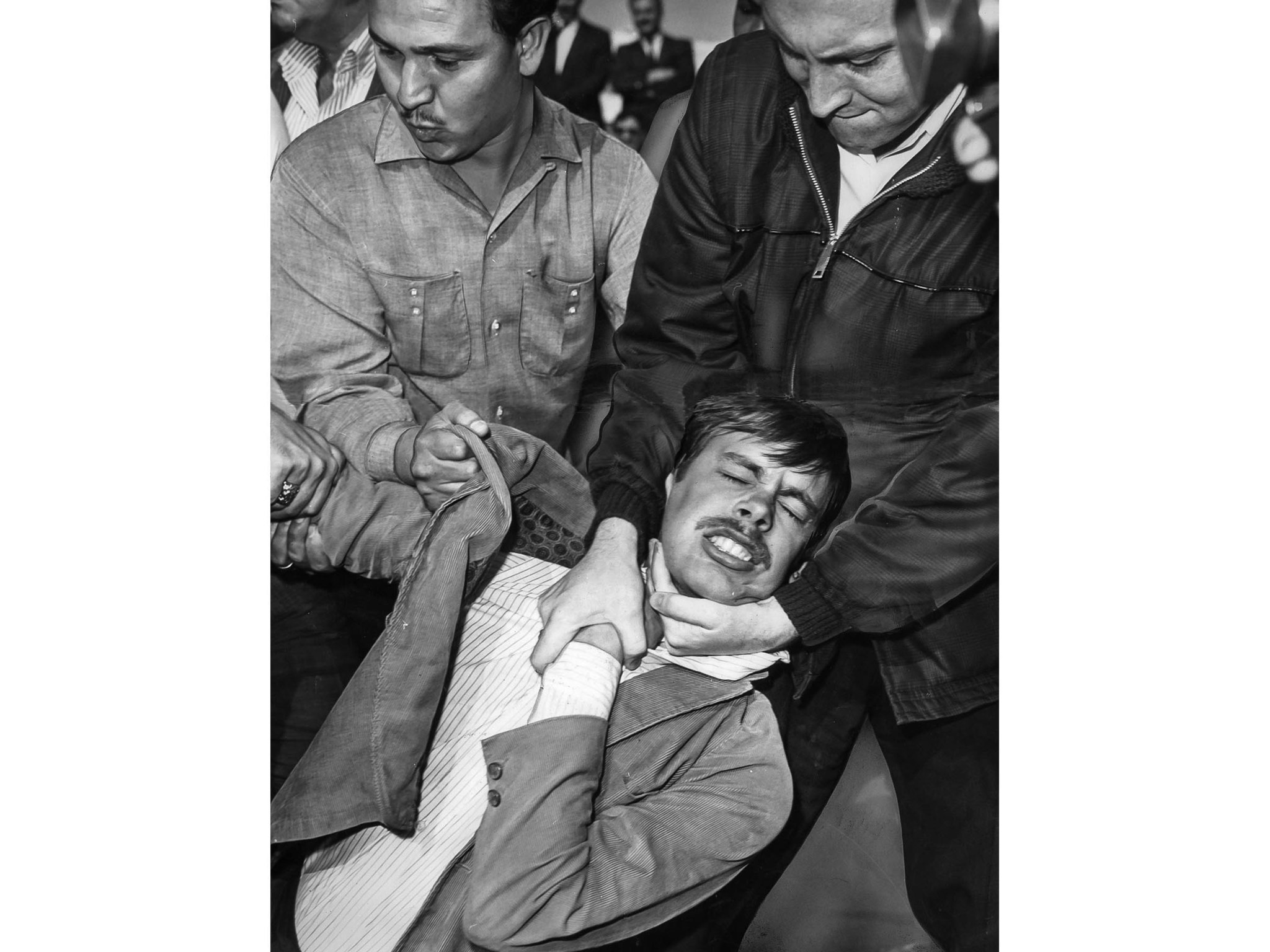 March 10, 1965: U.S. deputy marshals forcibly remove a demonstrator from driveway entrance to Federa