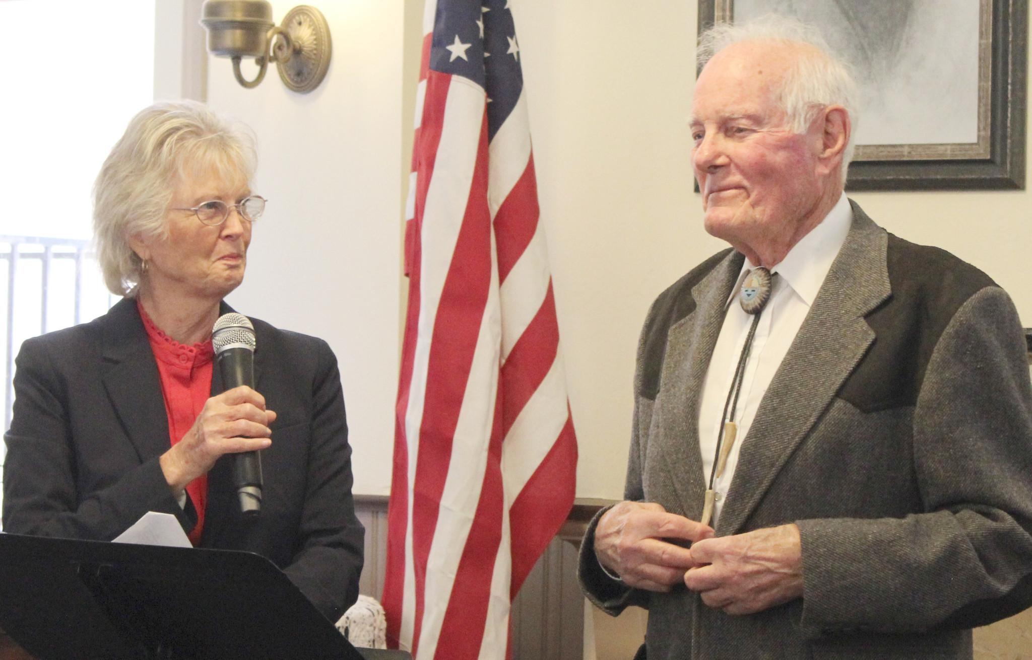 Supervisor Dianne Jacob and incoming Honorary Mayor John Degenfelder share a joke before she administers his oath of office.