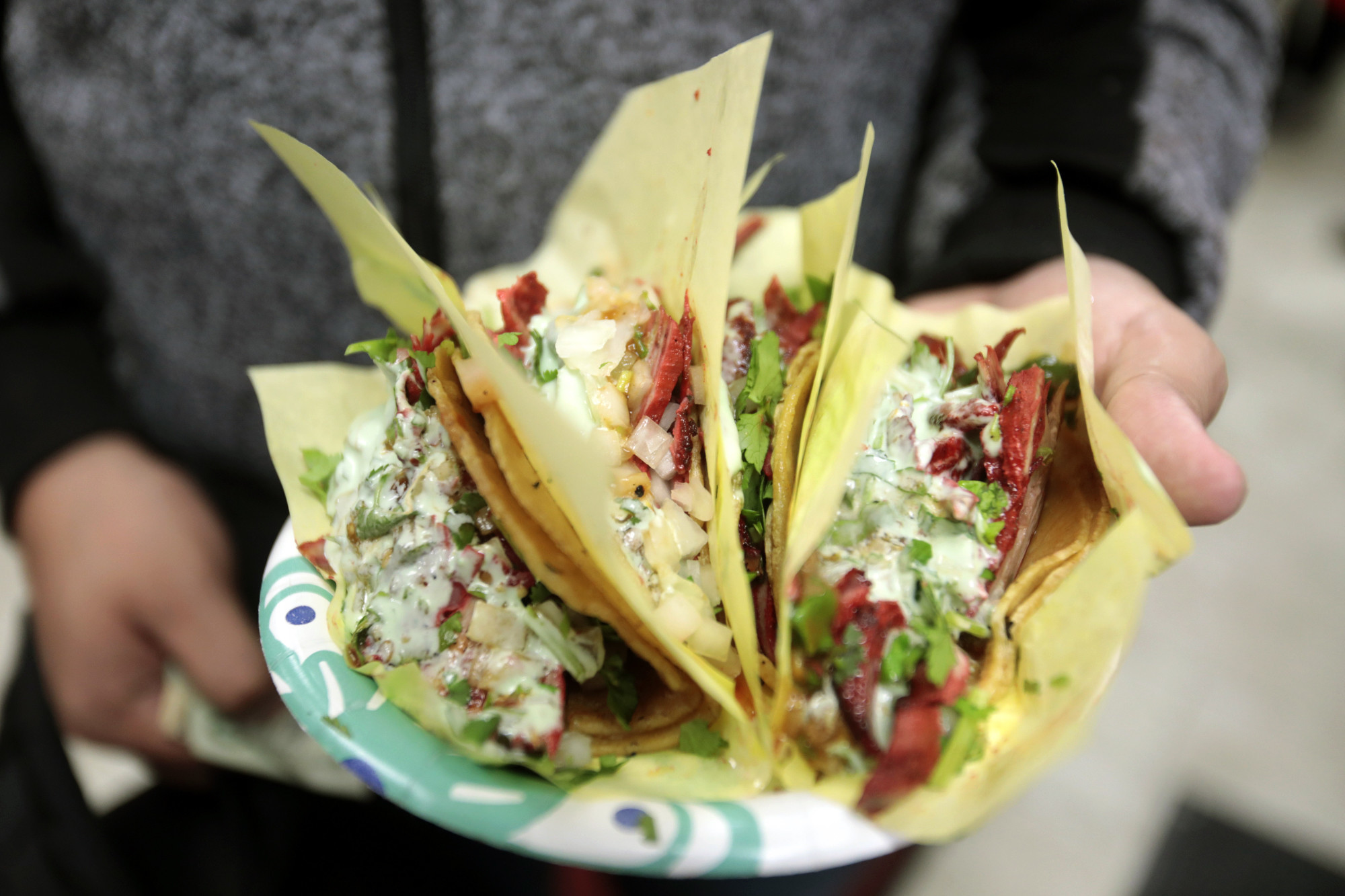 The Tijuana-style adobada (spicy pork) tacos with cilantro and avocado sauce at Tacos El G in the San Diego neighborhood of National City on Jan. 20.