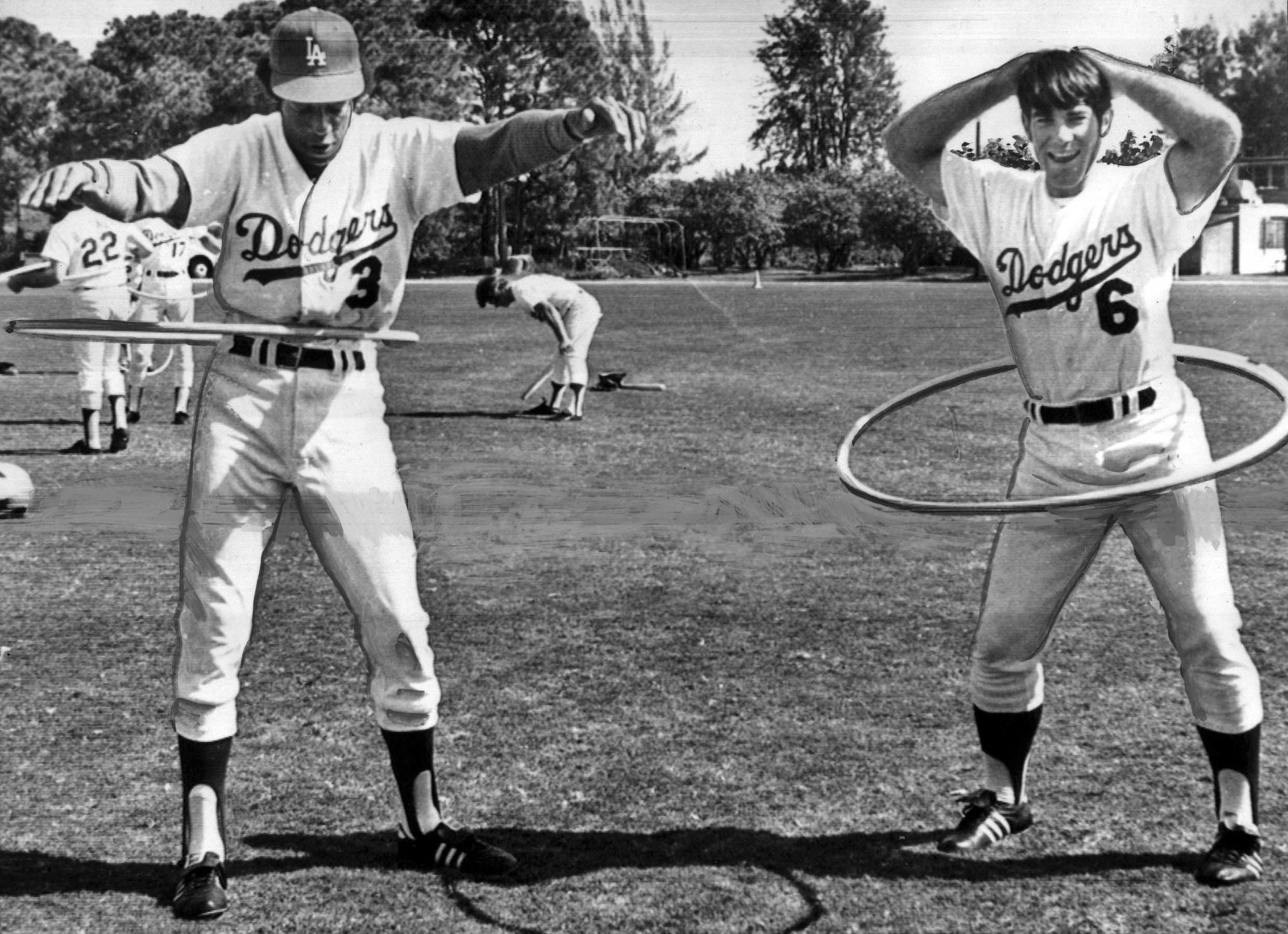 March 7, 1973: Los Angeles Dodgers Willie Davis, left, and Steve Garvey use hula hoops during an exe