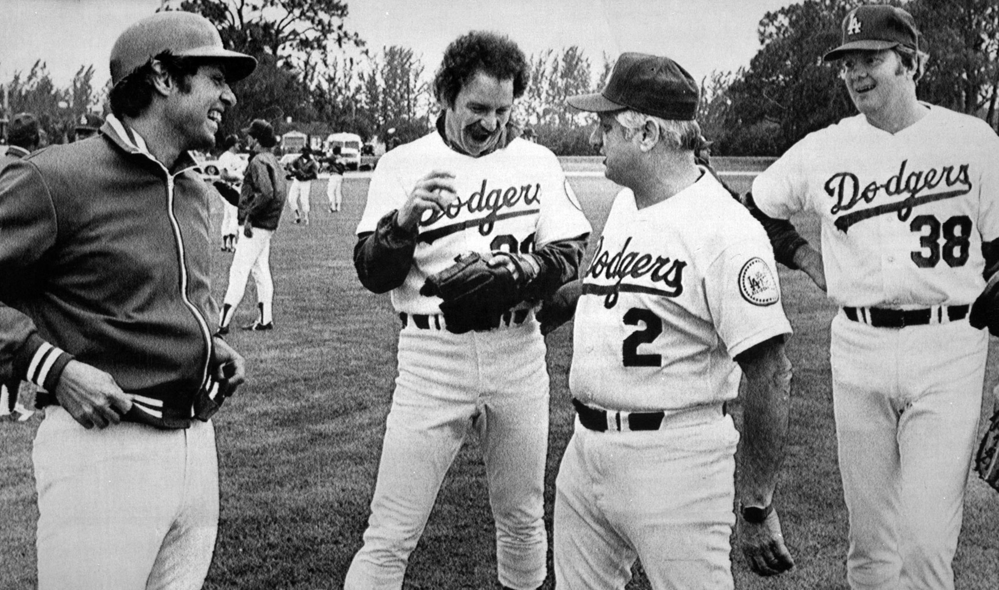 March 2, 1980: Manager Tommy Lasorda, second from right, chats with Jay Johnstone, left, Don Stanhouse and Dave Golt