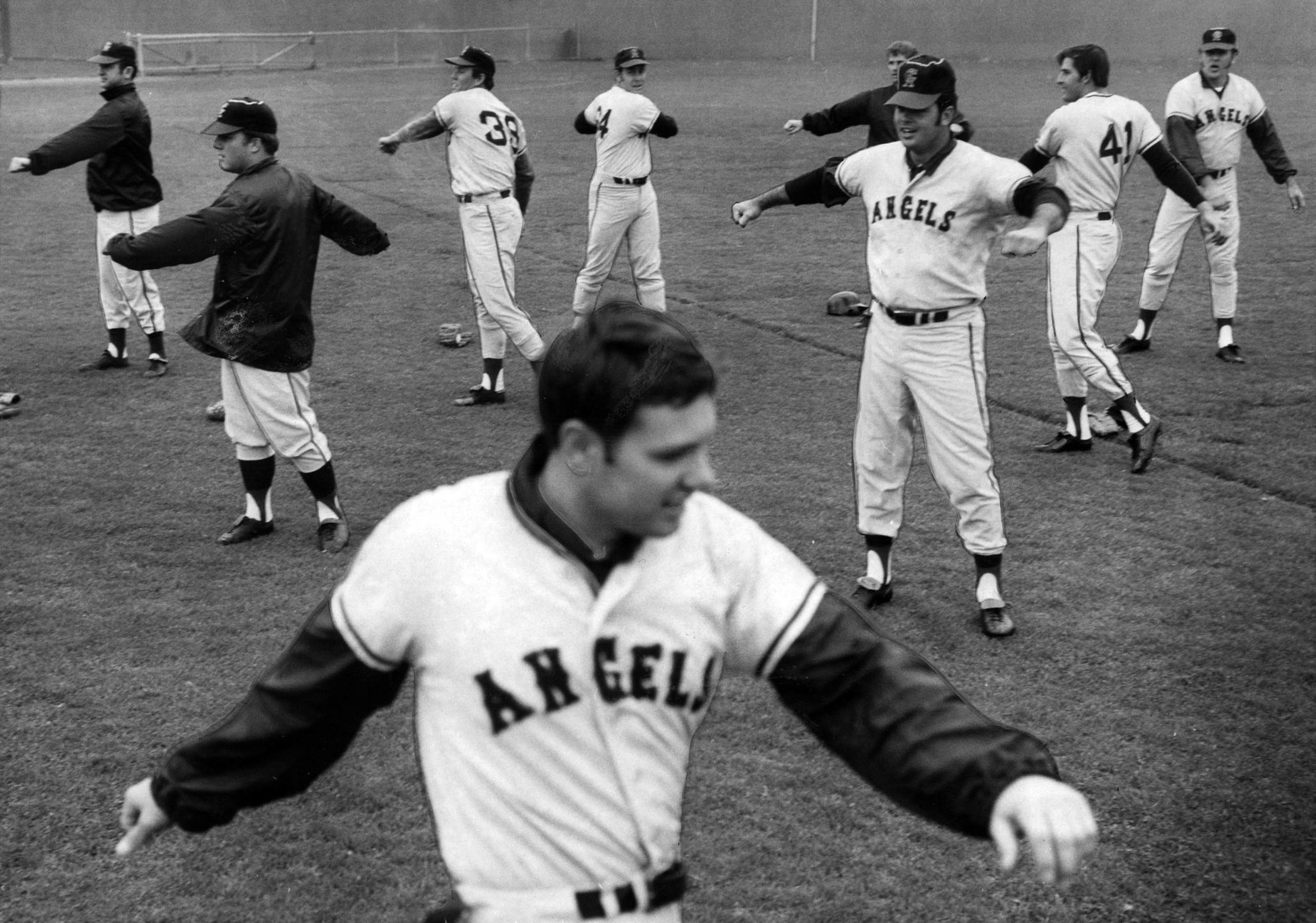 Feb. 9, 1970: Angels exercise with Jay Johnstone, foreground, leading them in workout at Blair Field