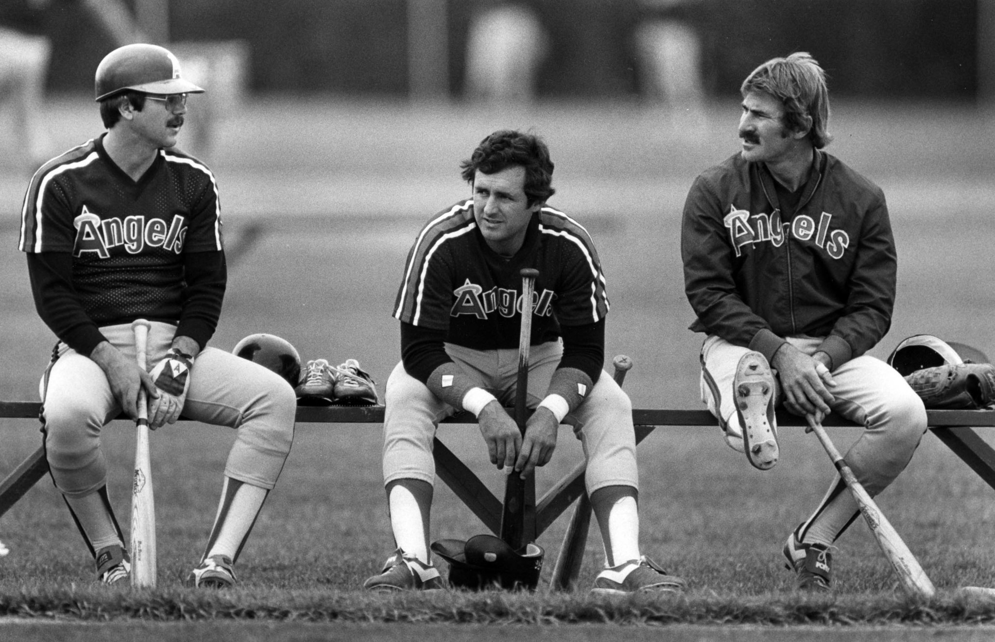 March 1983: Angels Tim Foli, left, Fred Lynn and Bobby Brich chat between batting practice during sp