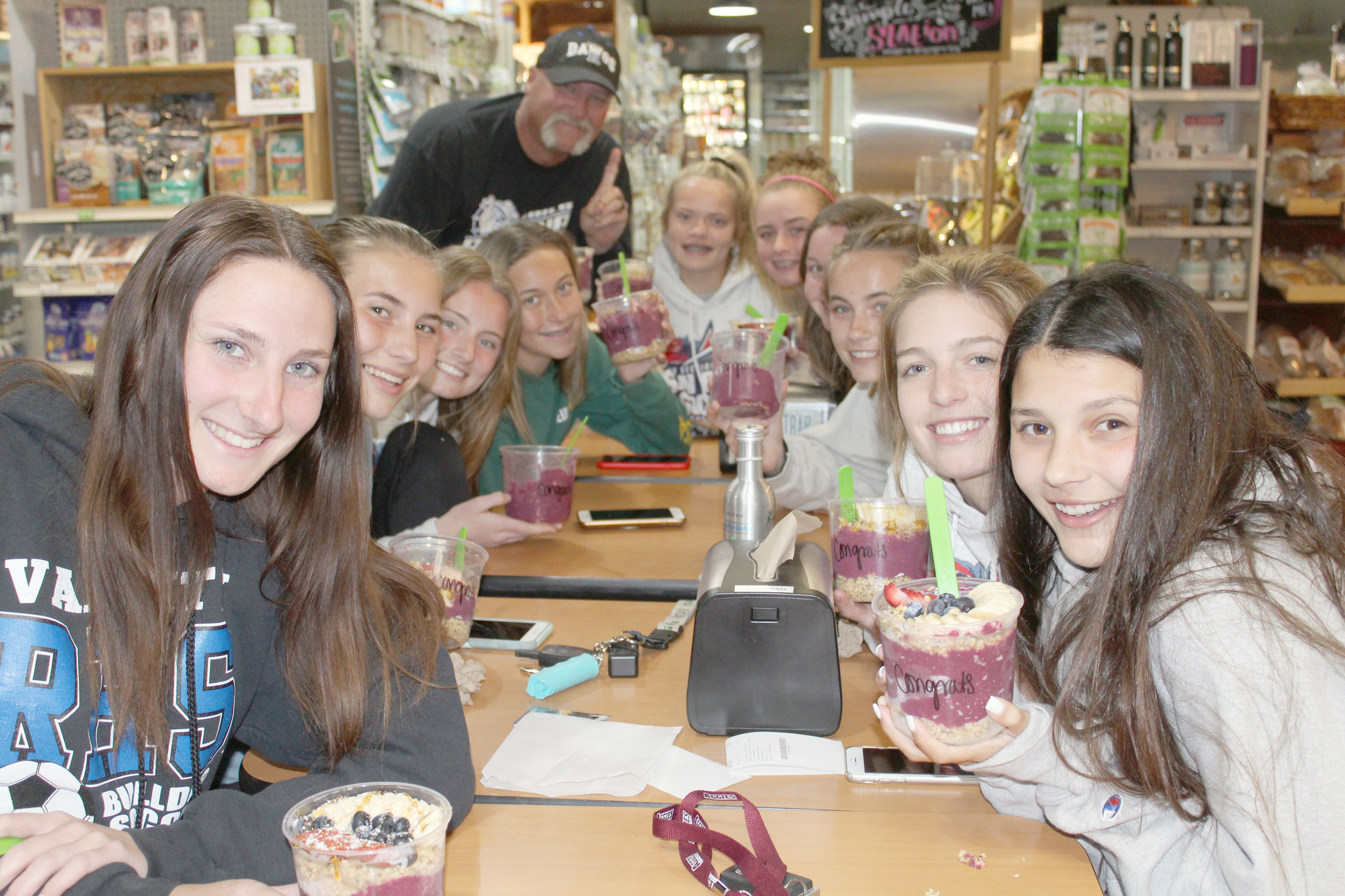 Ramona Family Naturals owners Victoria and Robert Bradley treat the Bulldog soccer players to acai bowls after they won the division championship.