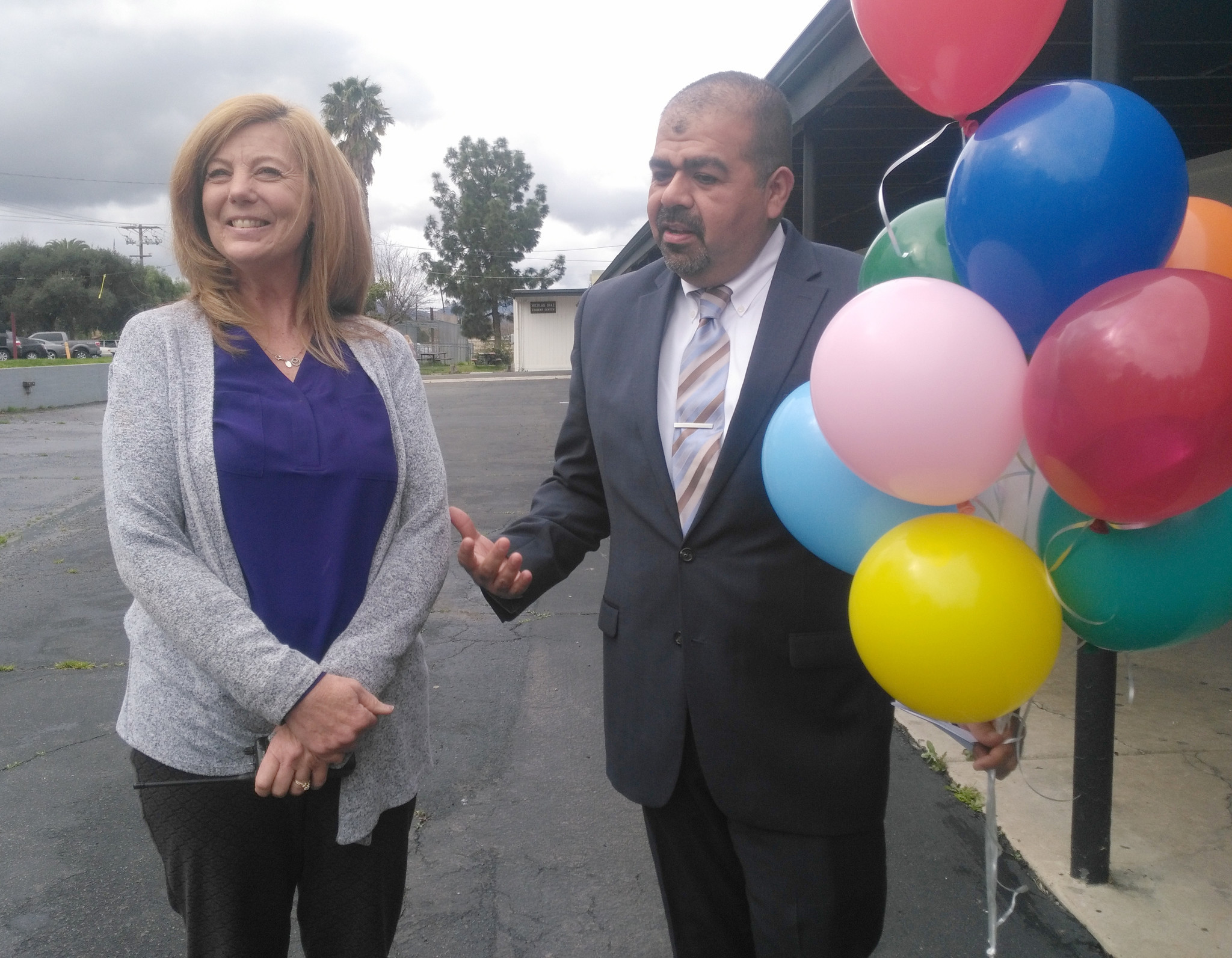 Ramona Unified School District Assistant Superintendent of Human Resources Joel Garcia tells Montecito High School Secretary Erin Kent the many reasons she received her award.