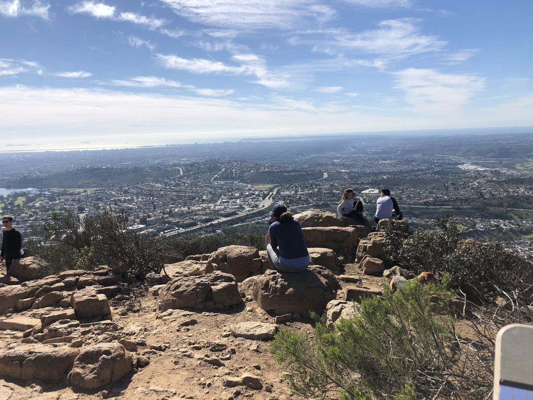 SAN DIEGO, CA-- Hikers on the summit of Cowles Mountain, San Diego's highest point, relax and enjoy
