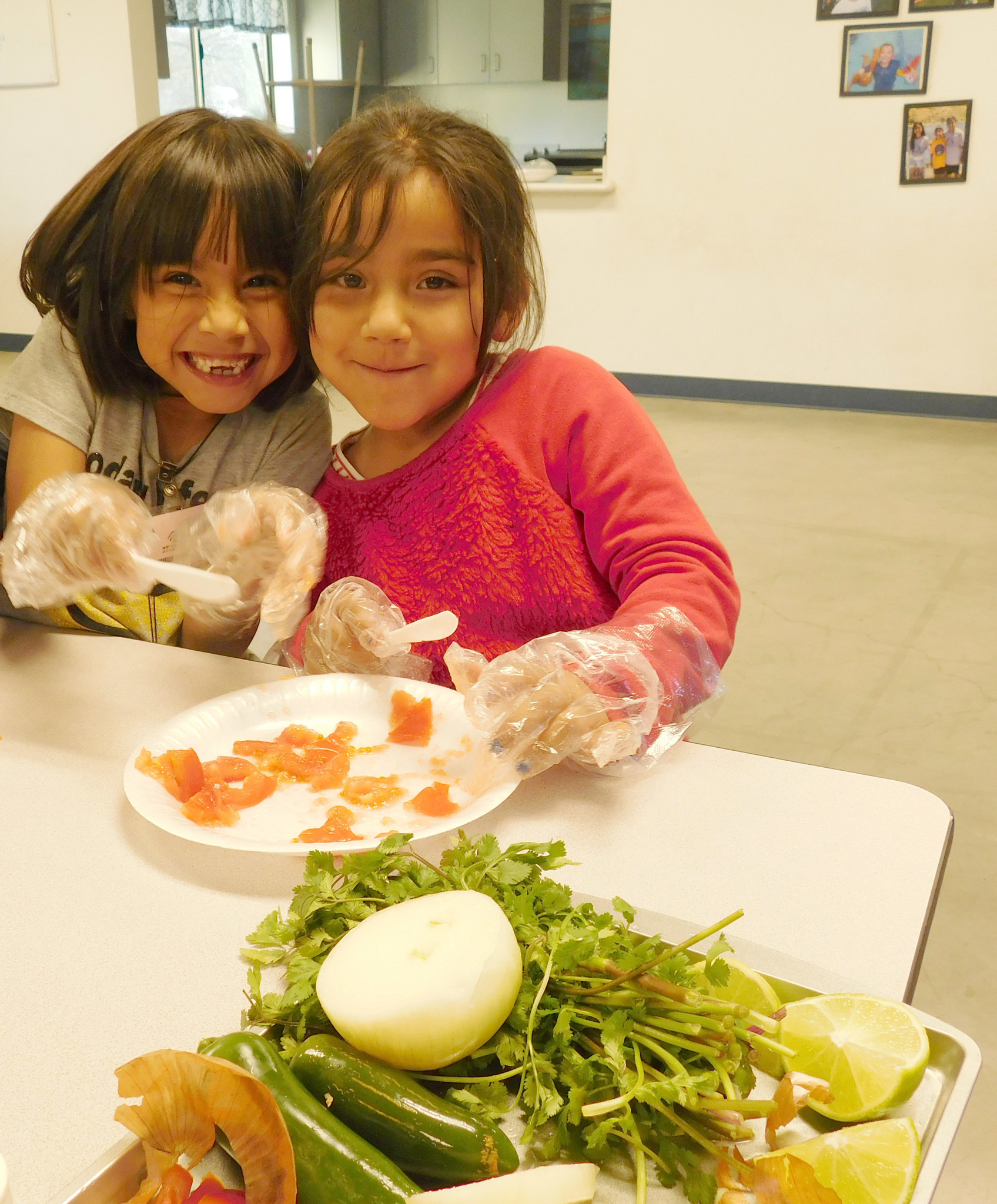 """Ramona Boys & Girls Club attendees Yasmin Carmona, left, and Paloma Curiel make salsa during a """"Big Change Friday"""" healthy lifestyle activity at the club."""