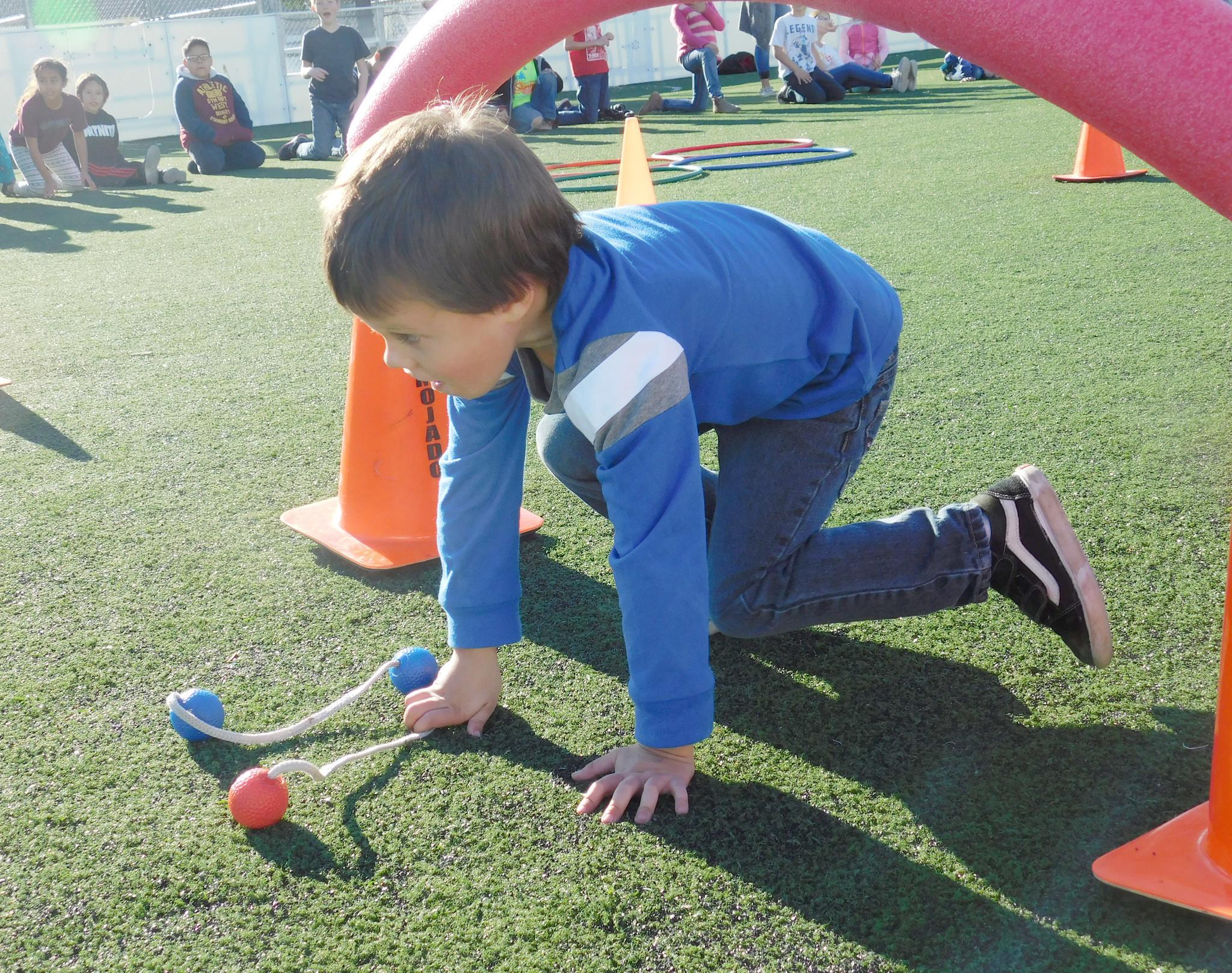 "Antonio Anjos navigates a ""Big Change Friday"" obstacle course activity."