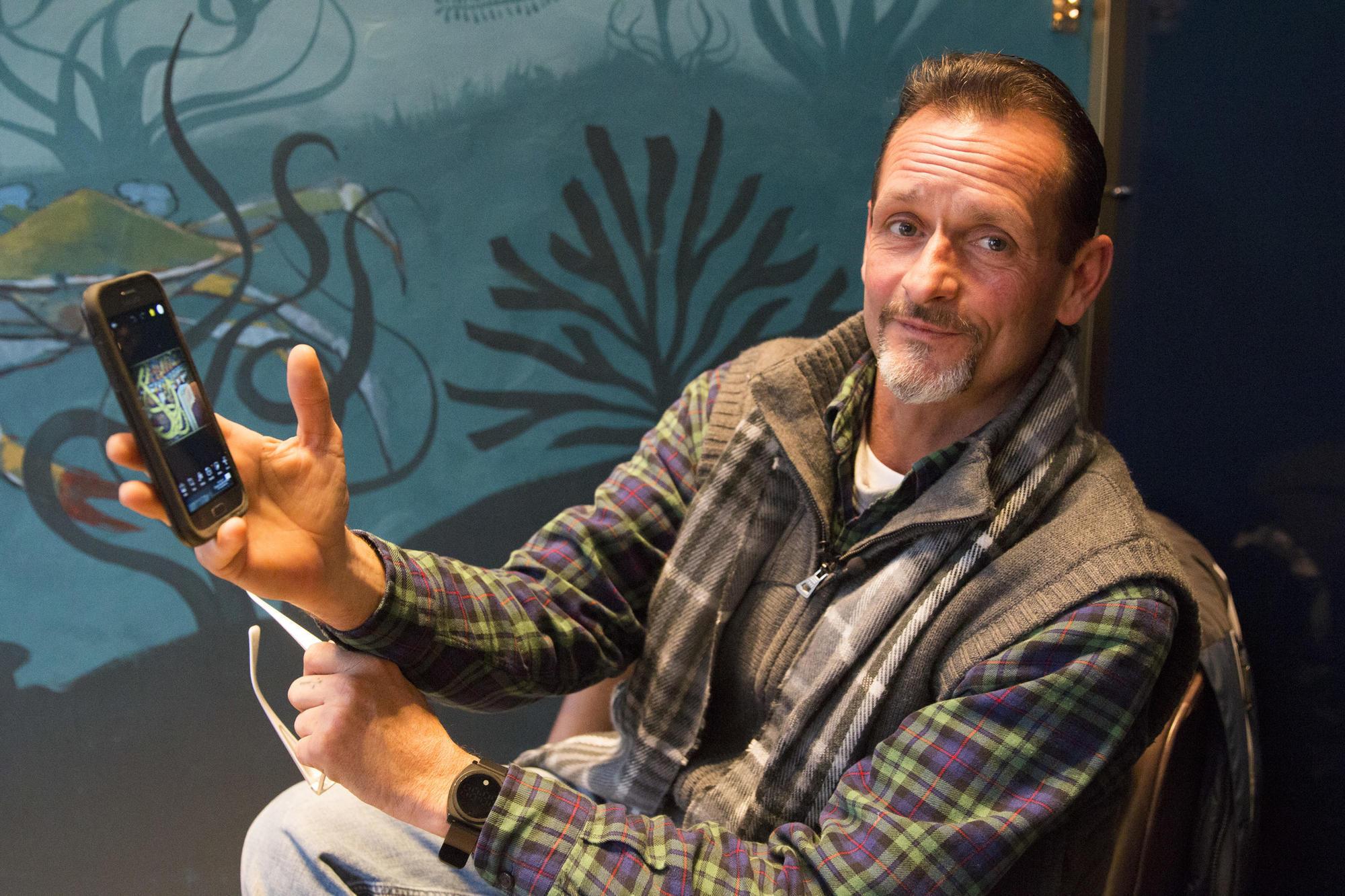 Homeless graphic artist makes art show premier