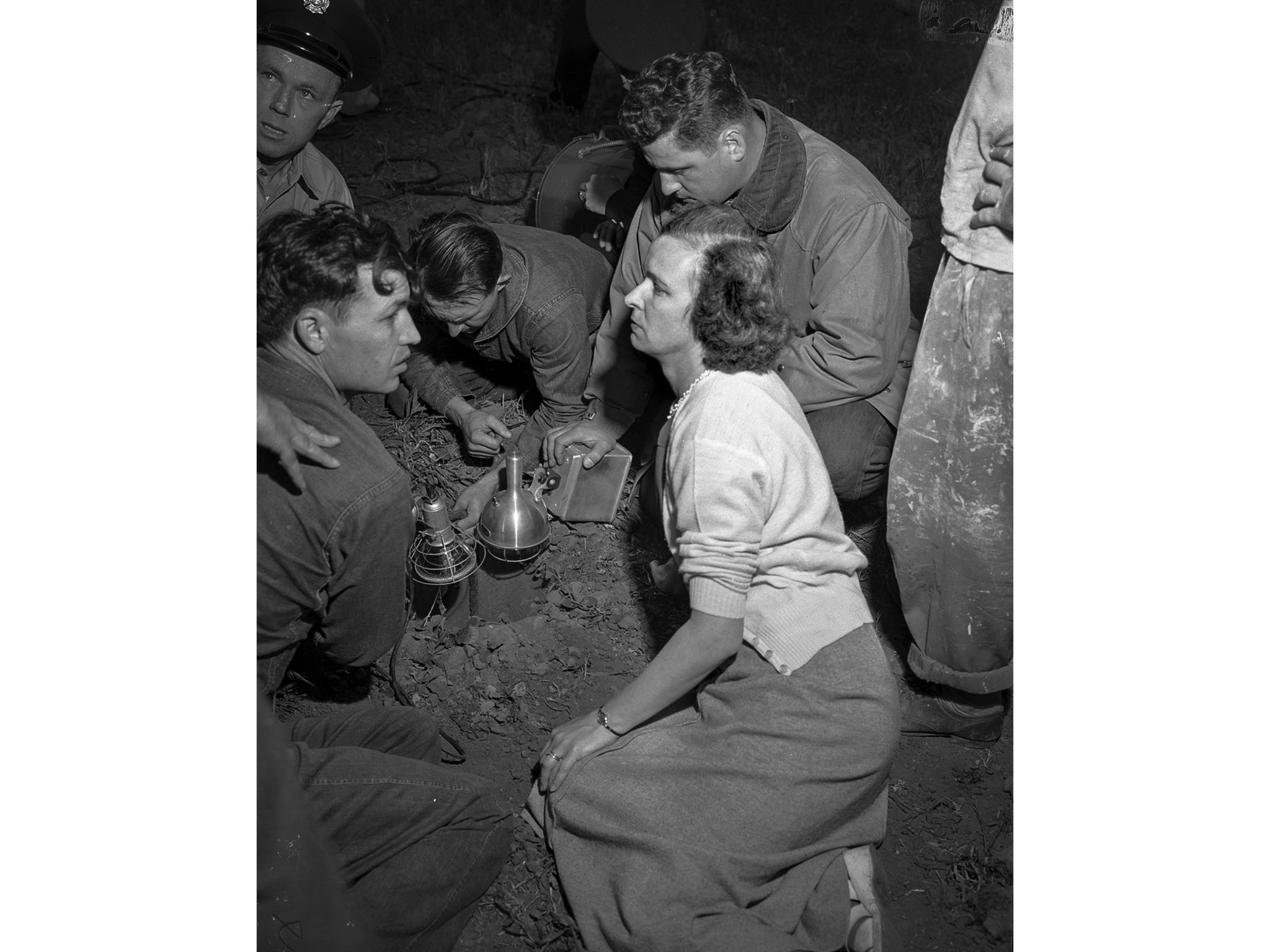 April 8, 1949: Mrs. Hamilton Lyon Jr., of Chula Vista, waits for rescue of her niece, Kathy Fiscus,