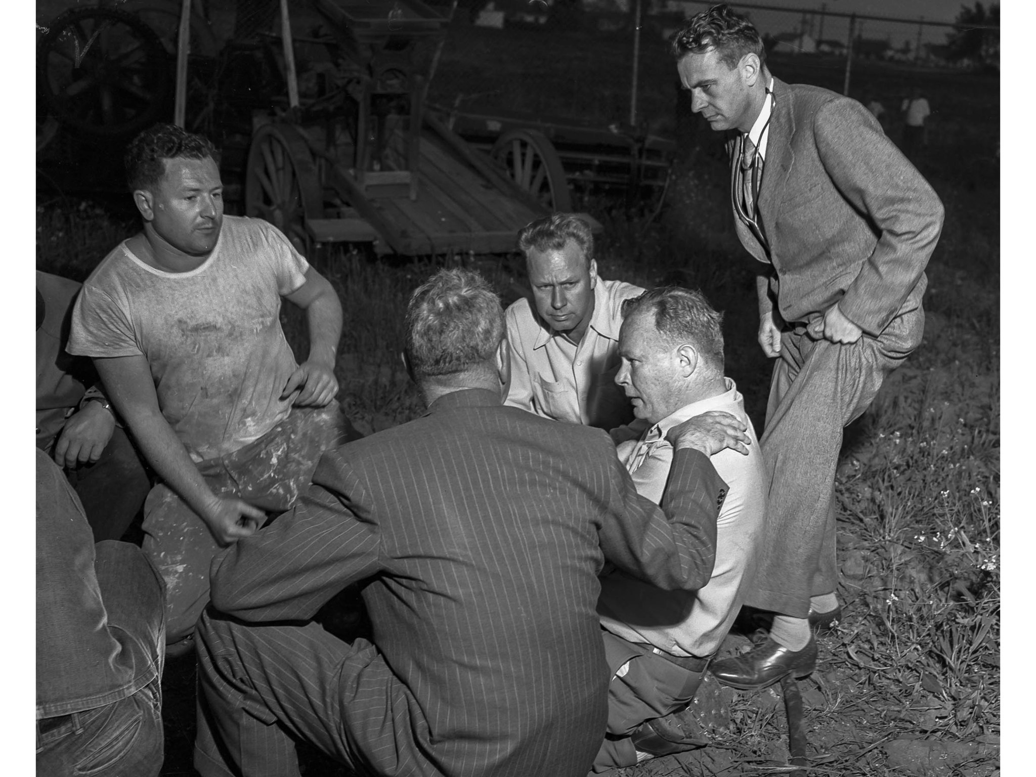 April 8, 1949: Rescue effort scene for Kathy Fiscus. Pasadena Fire Chief, back to camera, puts arm o