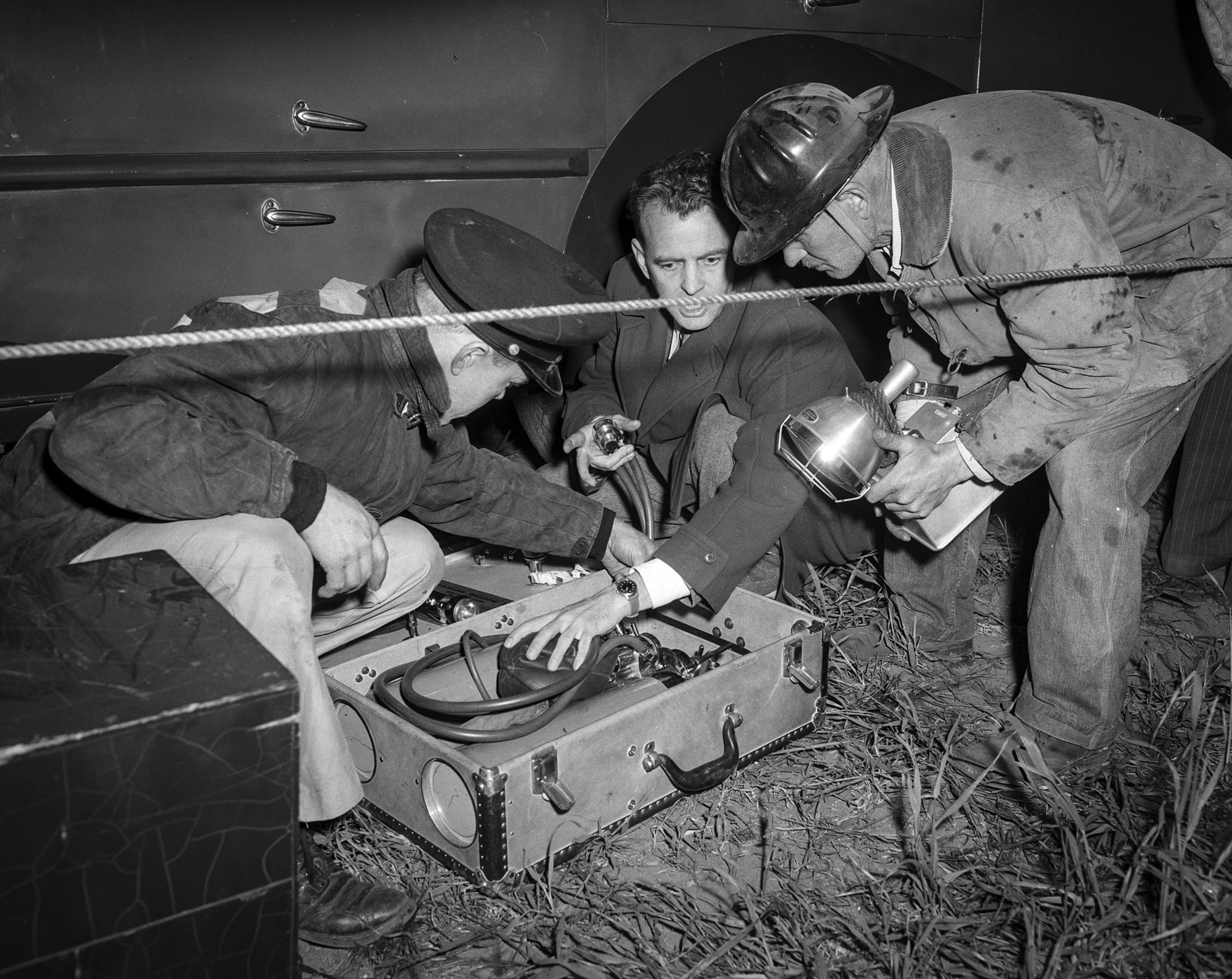 April 9, 1949: The Fiscus family physican Dr. Robert McCullock, makes sure his oxygen equipment is r