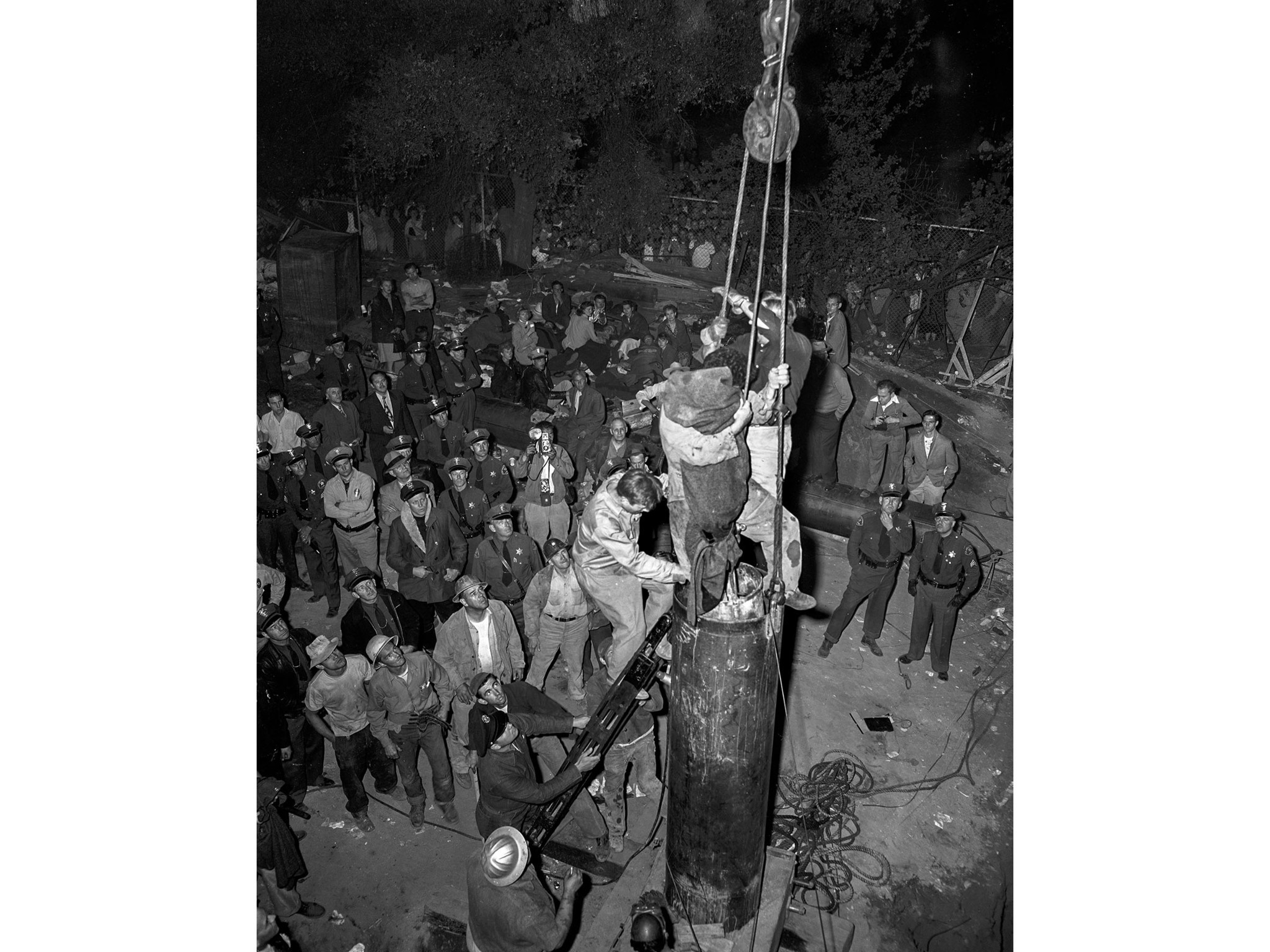 April 10, 1949: The body of Kathy Fiscus is brought to the surface during rescue operations in San M
