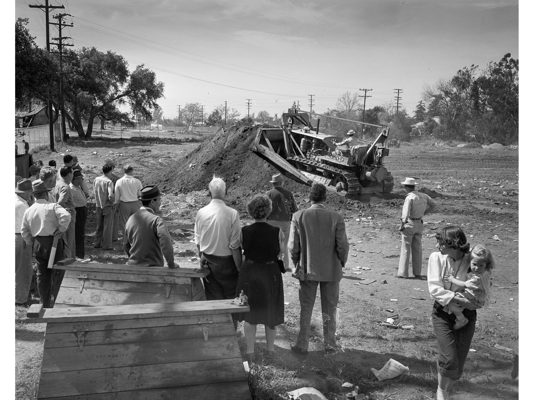 April 11, 1949: A bulldozer filled up holes dug in San Marino rescue effort for Kathy Fiscus. This p