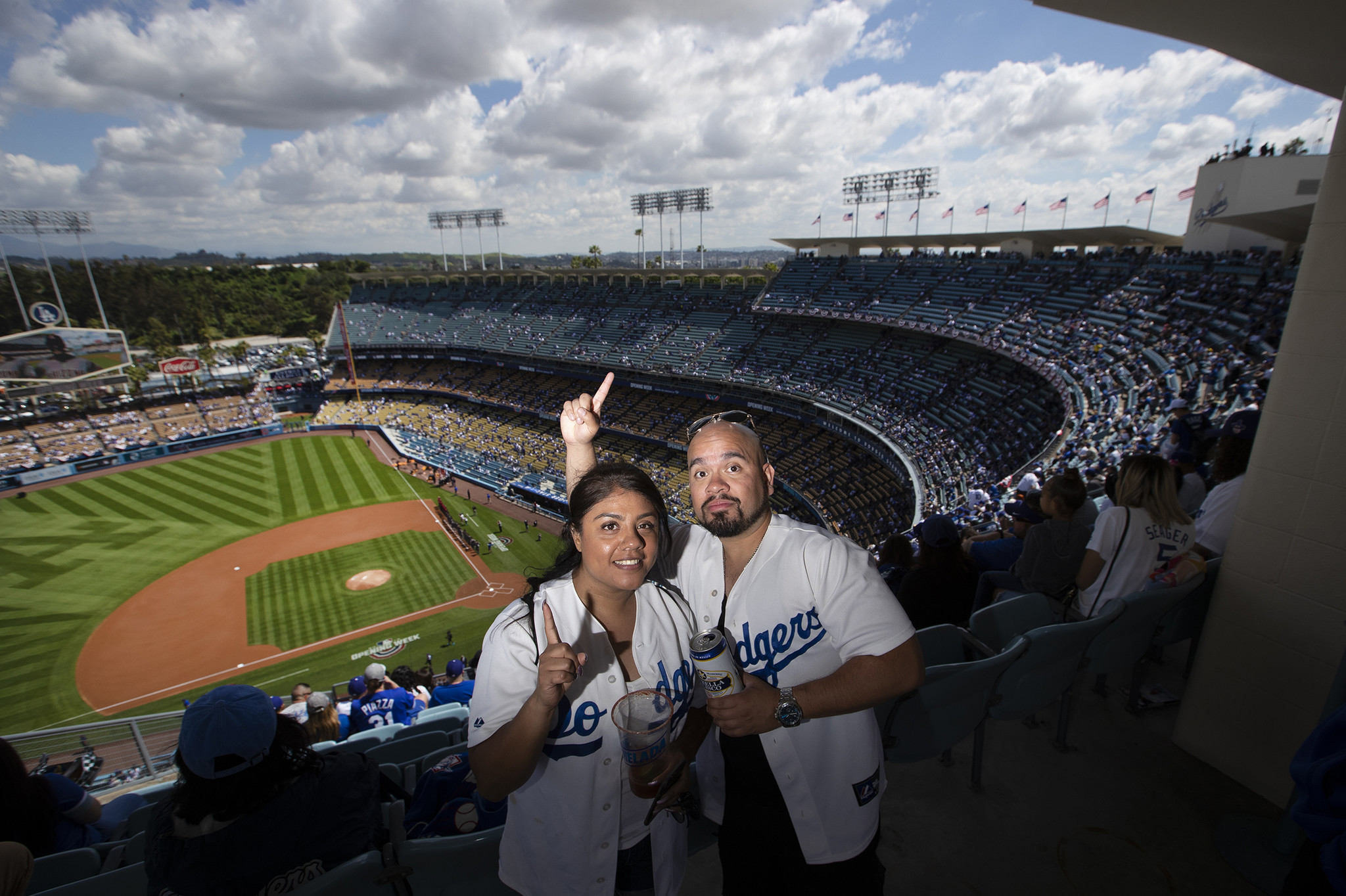 LOS ANGELES, CALIF. -- THURSDAY, MARCH 28, 2019: Dodgers fans Gabby Lamas and Steve Arellamo, of Los