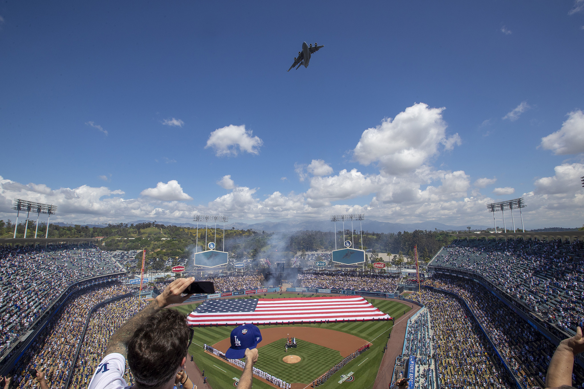 LOS ANGELES, CALIF. -- THURSDAY, MARCH 28, 2019: A C-17 Globemaster flies over the stadium during th