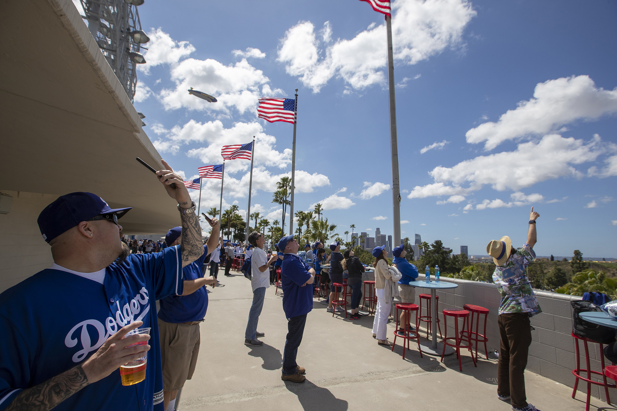 LOS ANGELES, CALIF. -- THURSDAY, MARCH 28, 2019: Dodgers fans watch the U.S. Army Golden Knights par