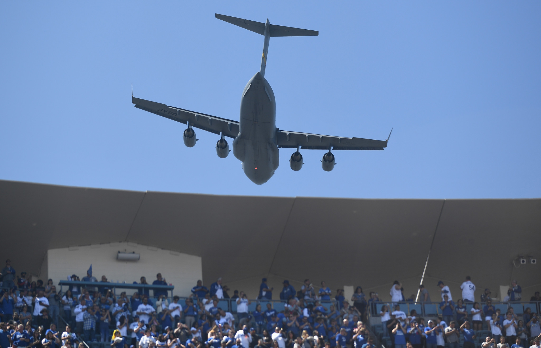 LOS ANGELES, CALIFORNIA MARCH 25, 2019-A military plane flies over Dodger Stadium during opening day