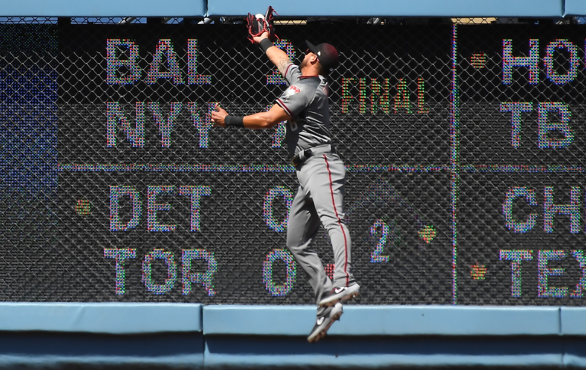 LOS ANGELES, CALIFORNIA MARCH 25, 2019-Diamondbacks left fielder David Peralta leaps but can't make