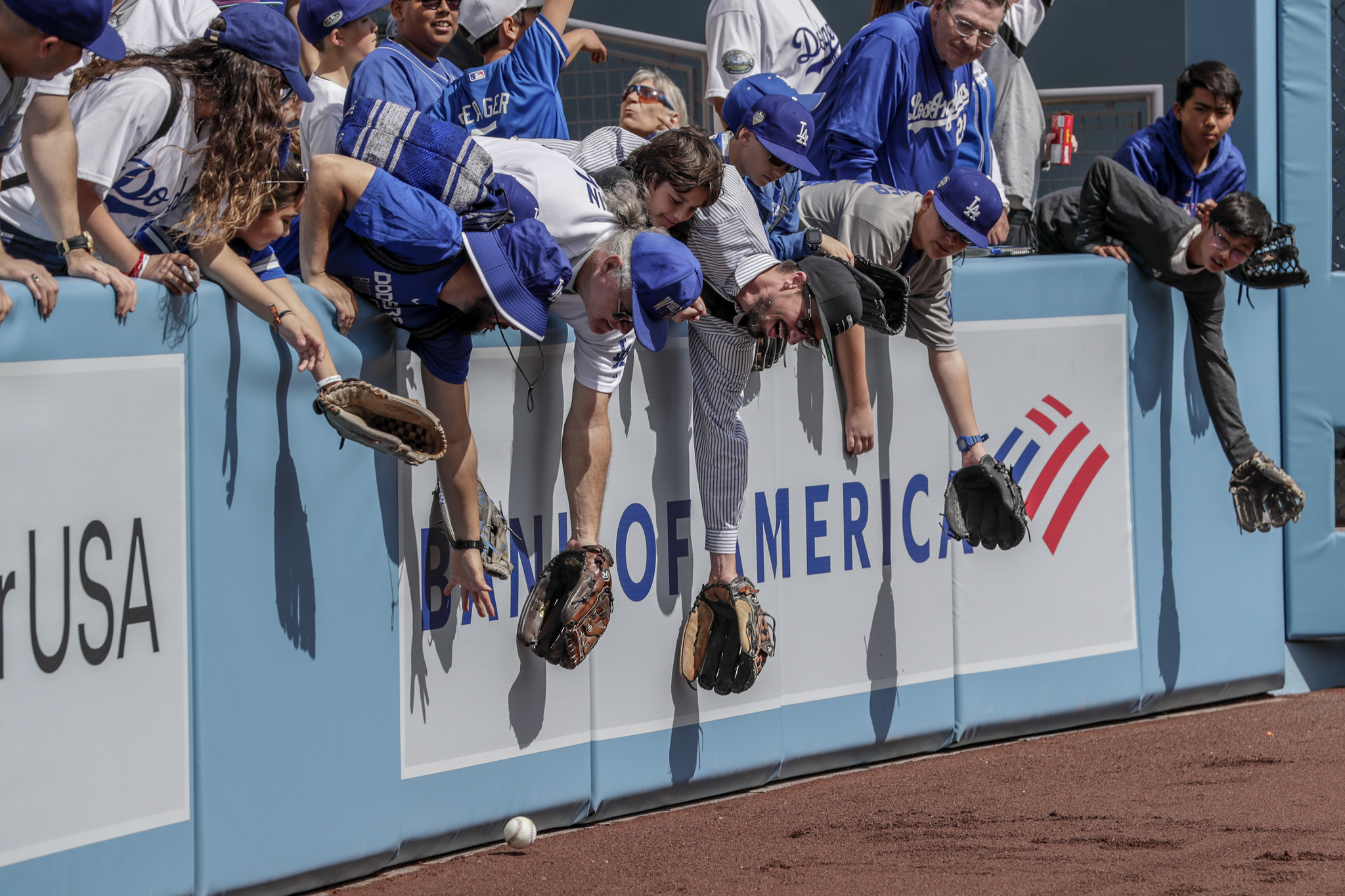 LOS ANGELES, CA, THURSDAY, MARCH 28, 2019 - Fans reach for a batting practice ball during pregame wa