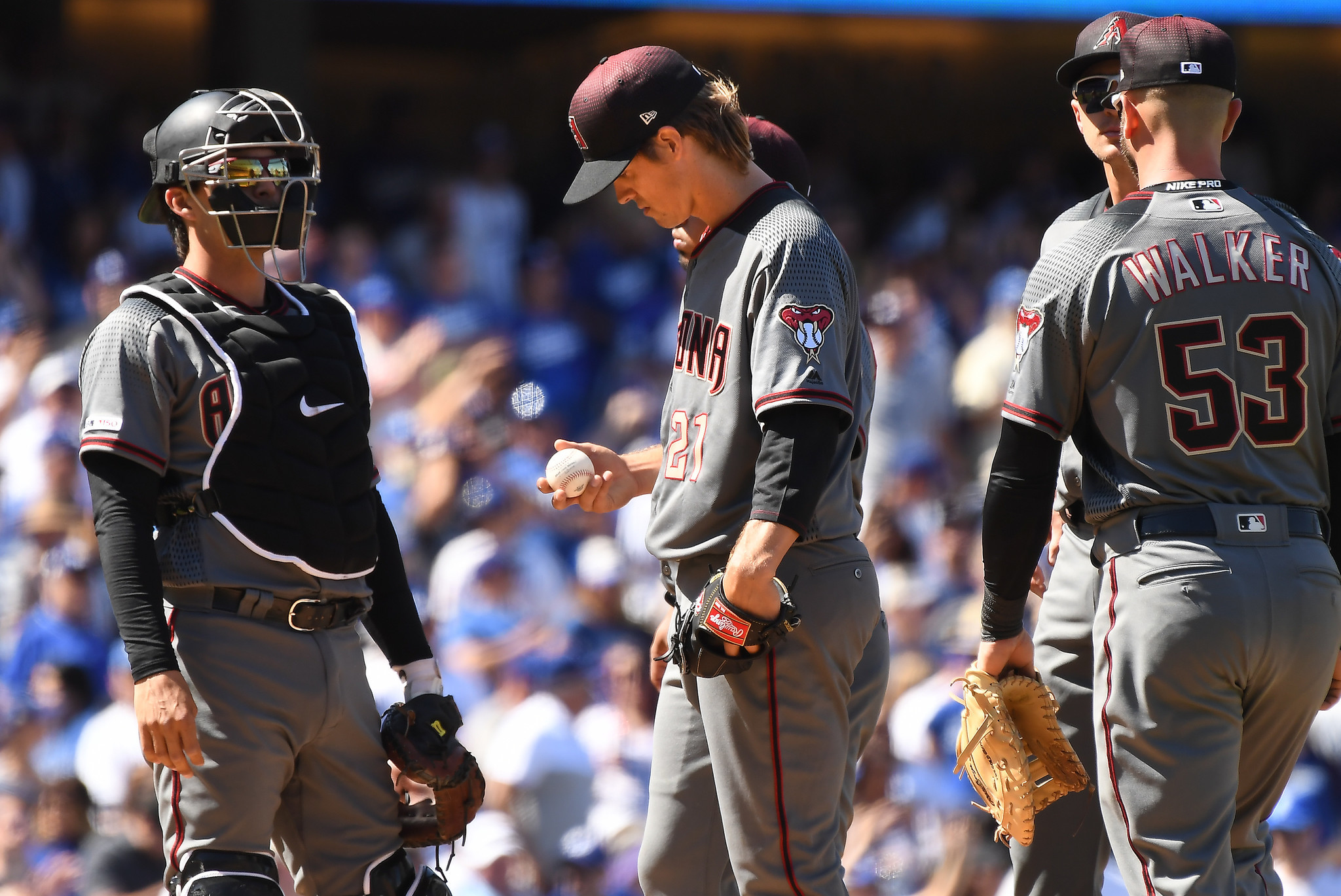 LOS ANGELES, CALIFORNIA MARCH 25, 2019-Diamondbacks pitcher looks at the ball after giving up a home