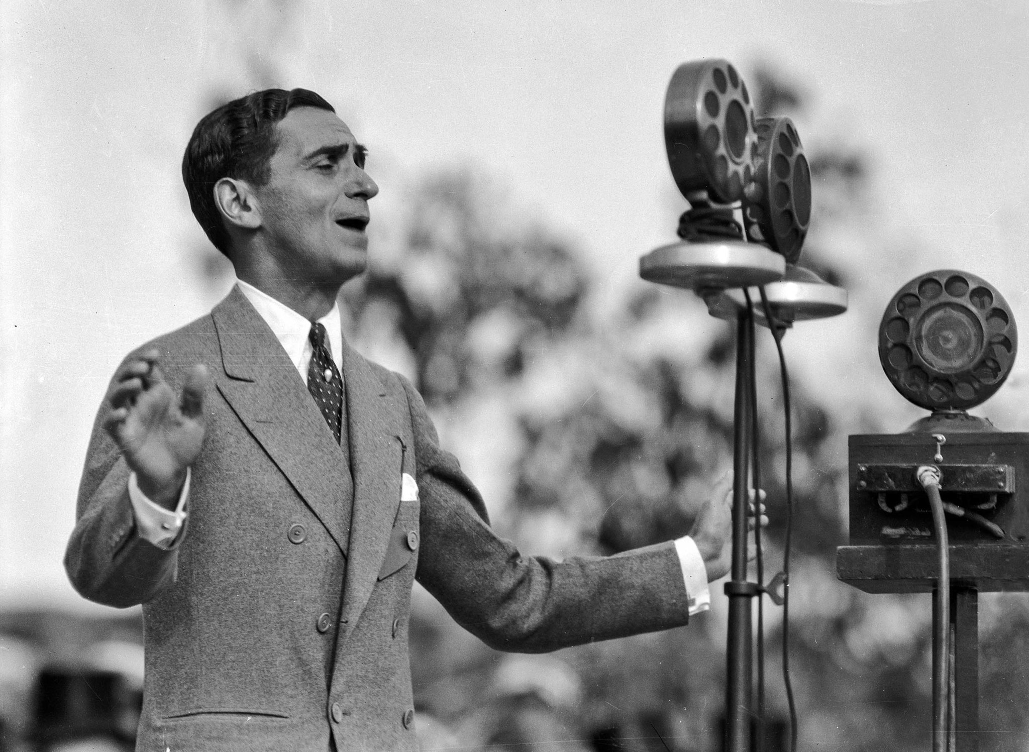 April 26, 1928: Irving Berlin sings at Los Angeles City Hall dedication ceremonies. This image is fr