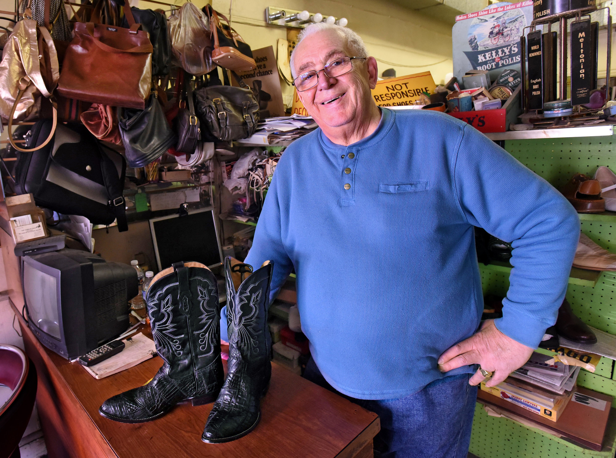 Alex Shkolnik, 74, owner of the Cobbler Shop at 219 West Saratoga Street for more than three decades