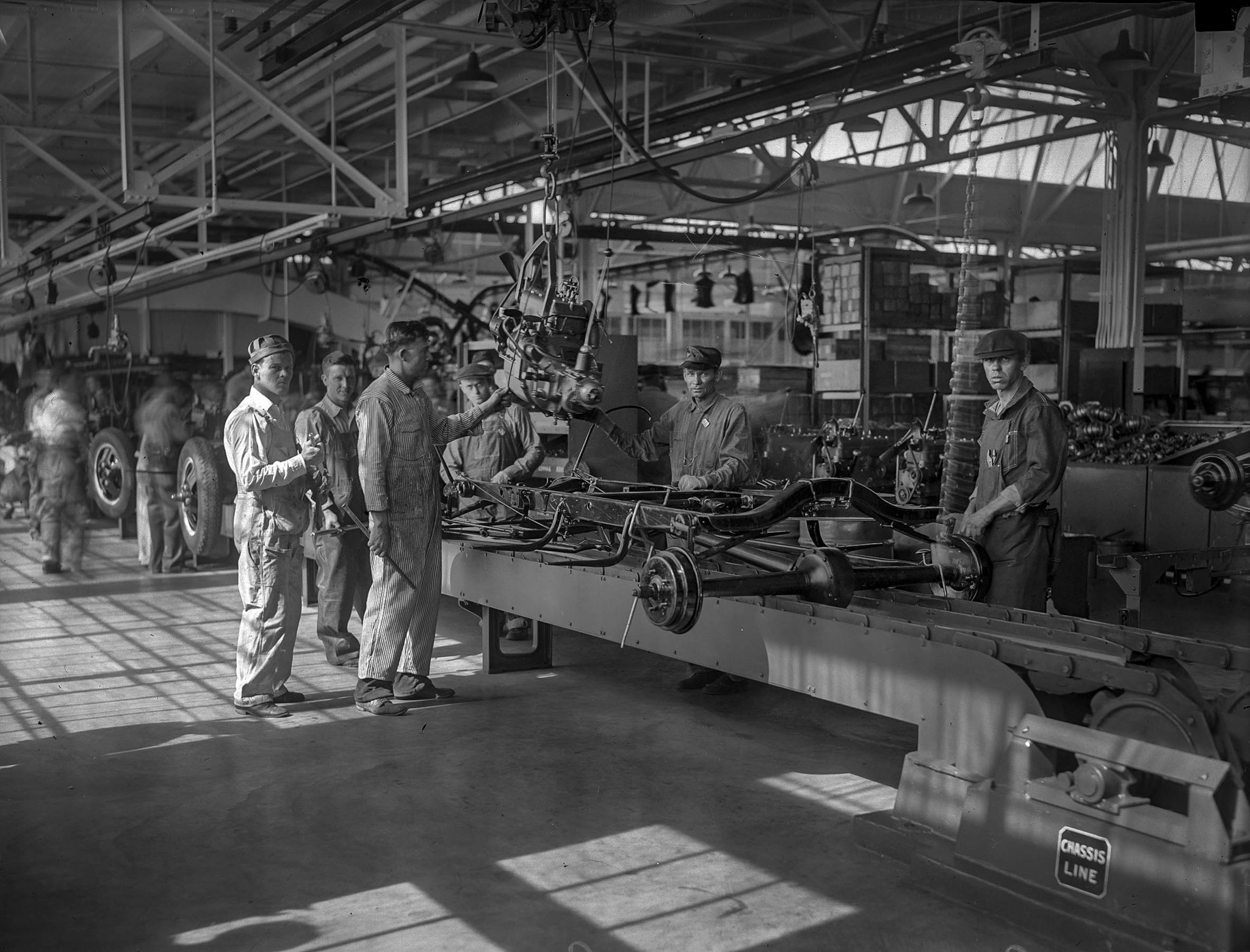 April 21, 1930: Workers on the assembly line at new Ford Motor plant in Long Beach A similar photo a