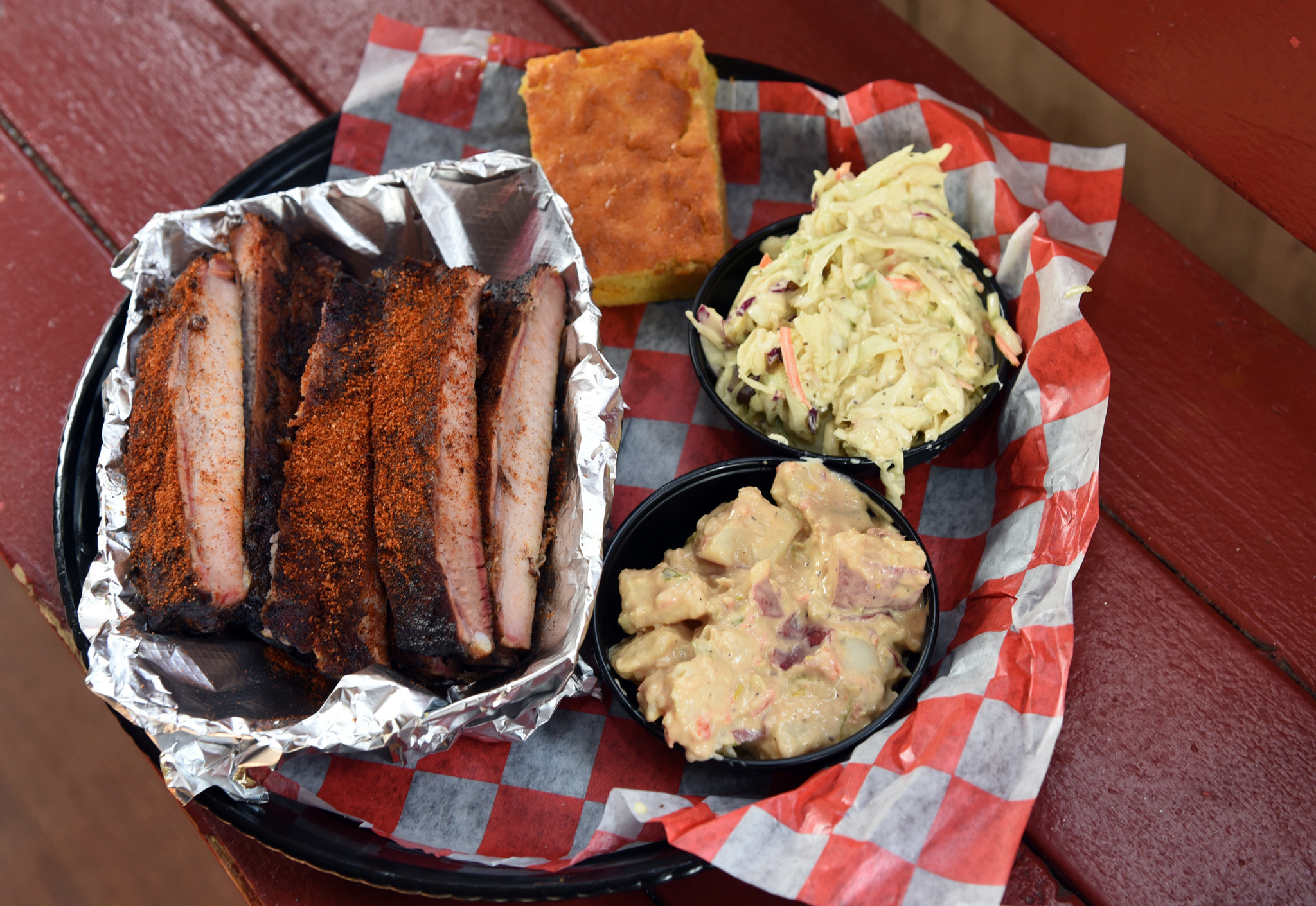Barbecue beef and sides of potato salad, coleslaw and cornbread from Andy Nelson's Southern Pit Barb