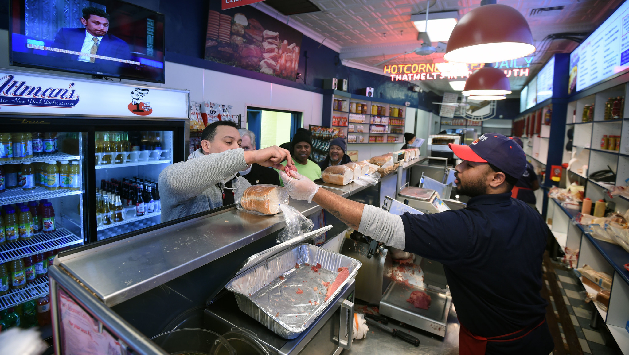 Baltimore, Md--1/10/18--Left, Mo Kholfi, Bayview, gets a sample at Attman's delicatessen as Kevin Ba