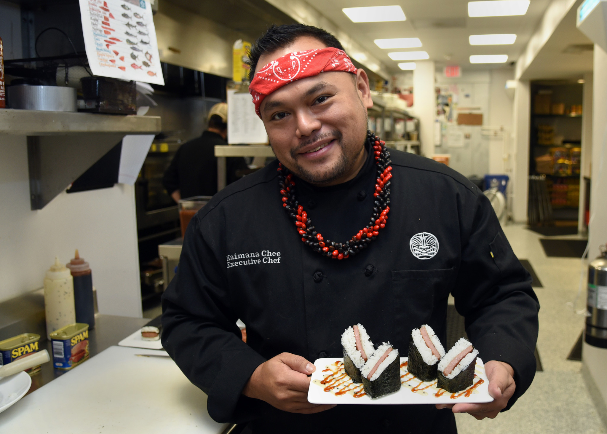 Fallston, MD--October 12, 2017--Kaimana Chee, executive chef at Uncle's Hawaiian Grindz, holds a dis