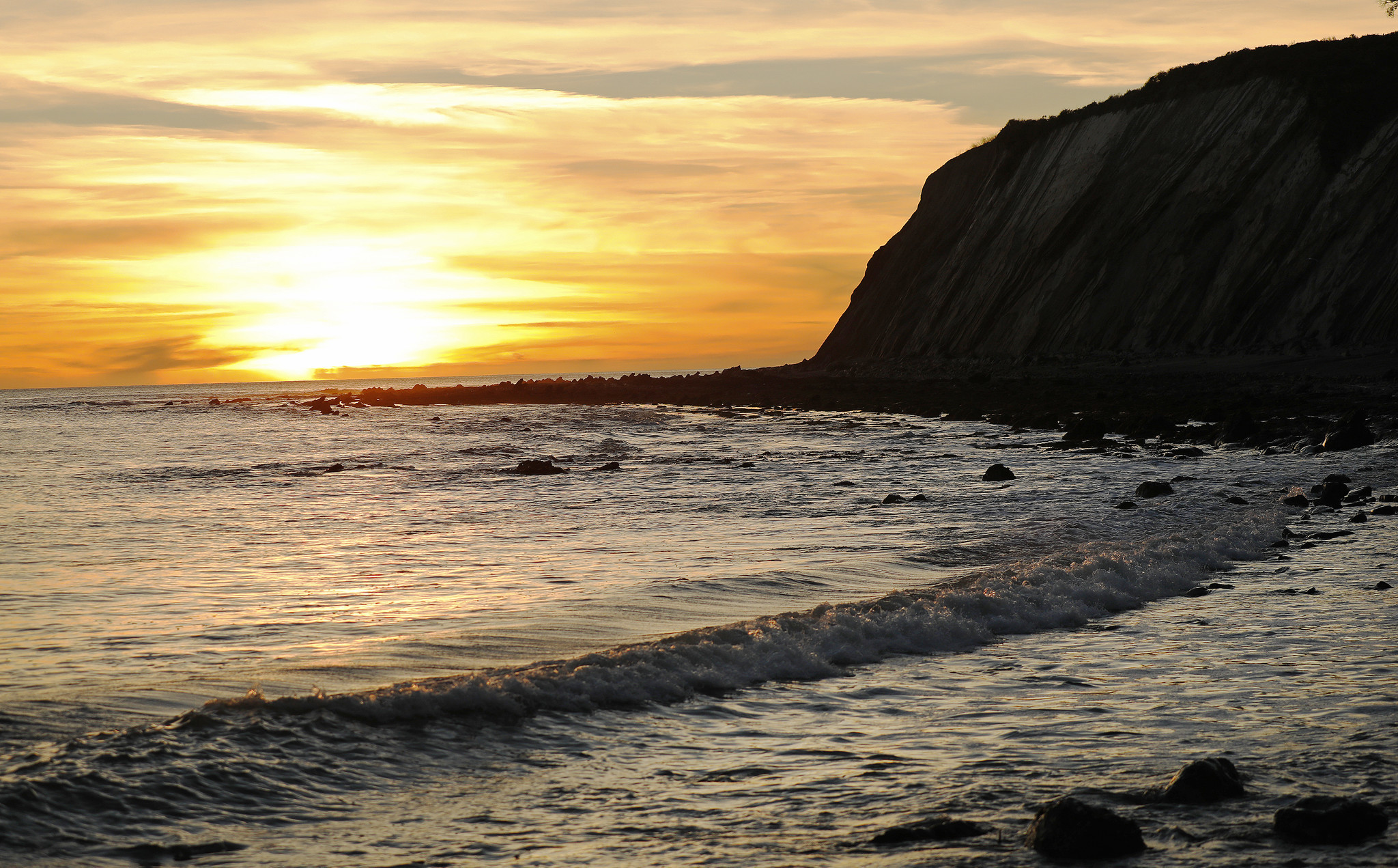 Winter sunset at Alegria Creek beach in Hollister Ranch in S
