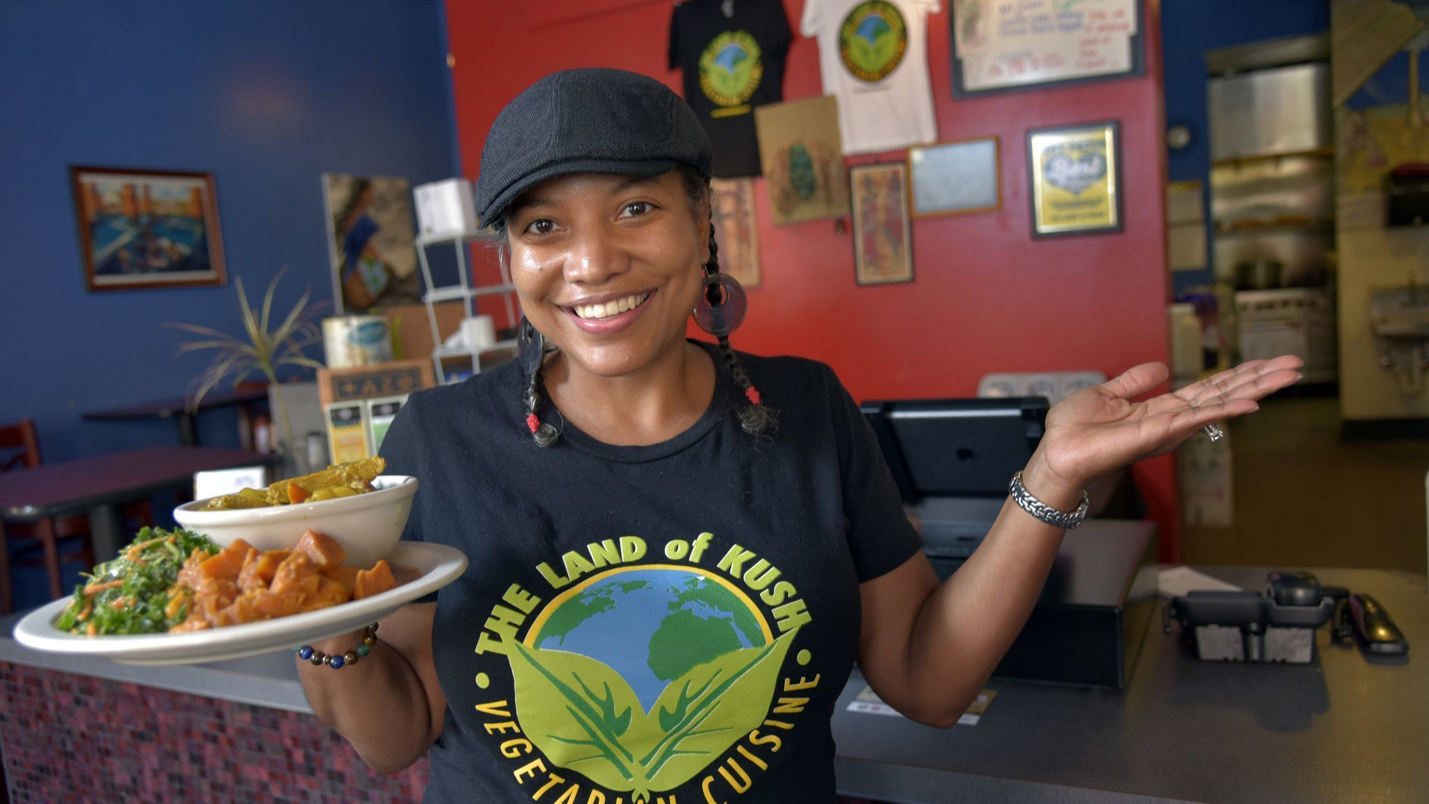 Baltimore, MD-9/16/15--Naijha Wright, co-owner of Land of Kush and also an organizer for Vegan SoulF