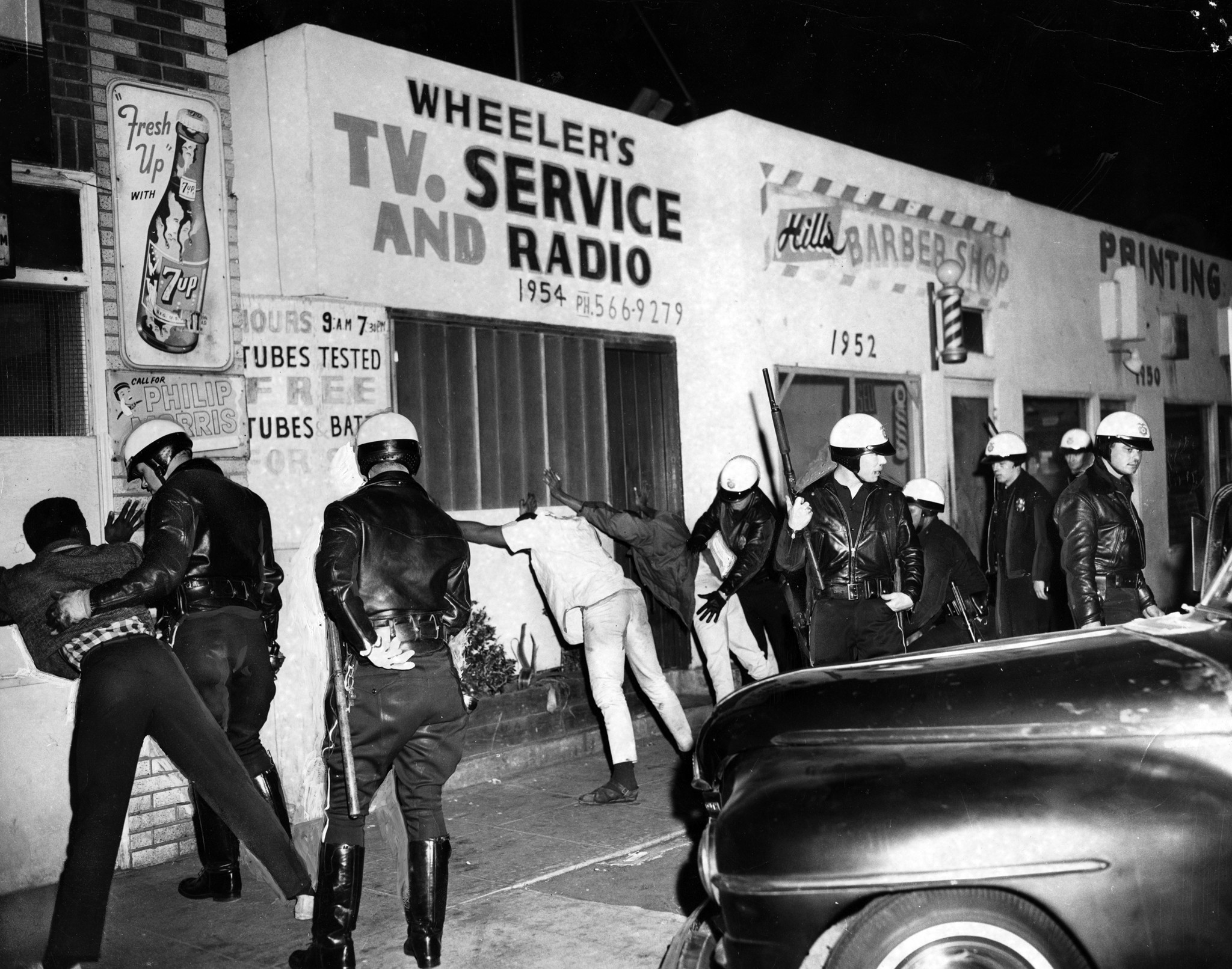 Cliff Wesselmann --Search for weapons, Watts Riots, 1965. Digital image from a photographic print. C