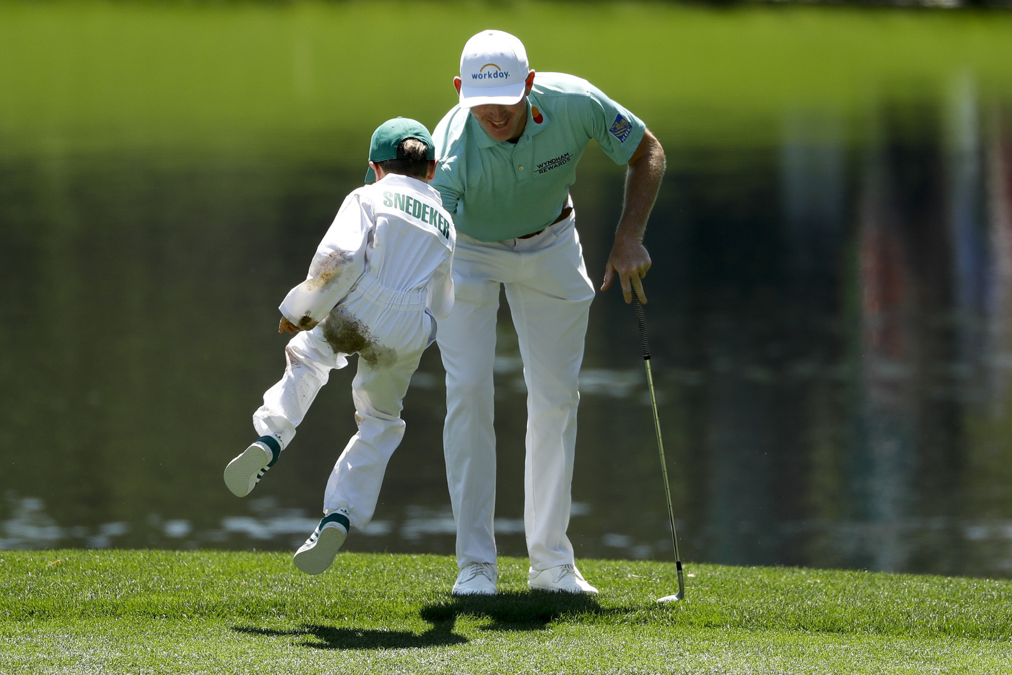 Brandt Snedeker celebrates his birdie with his son, Austin, 6, on the third hole during the par-3 go