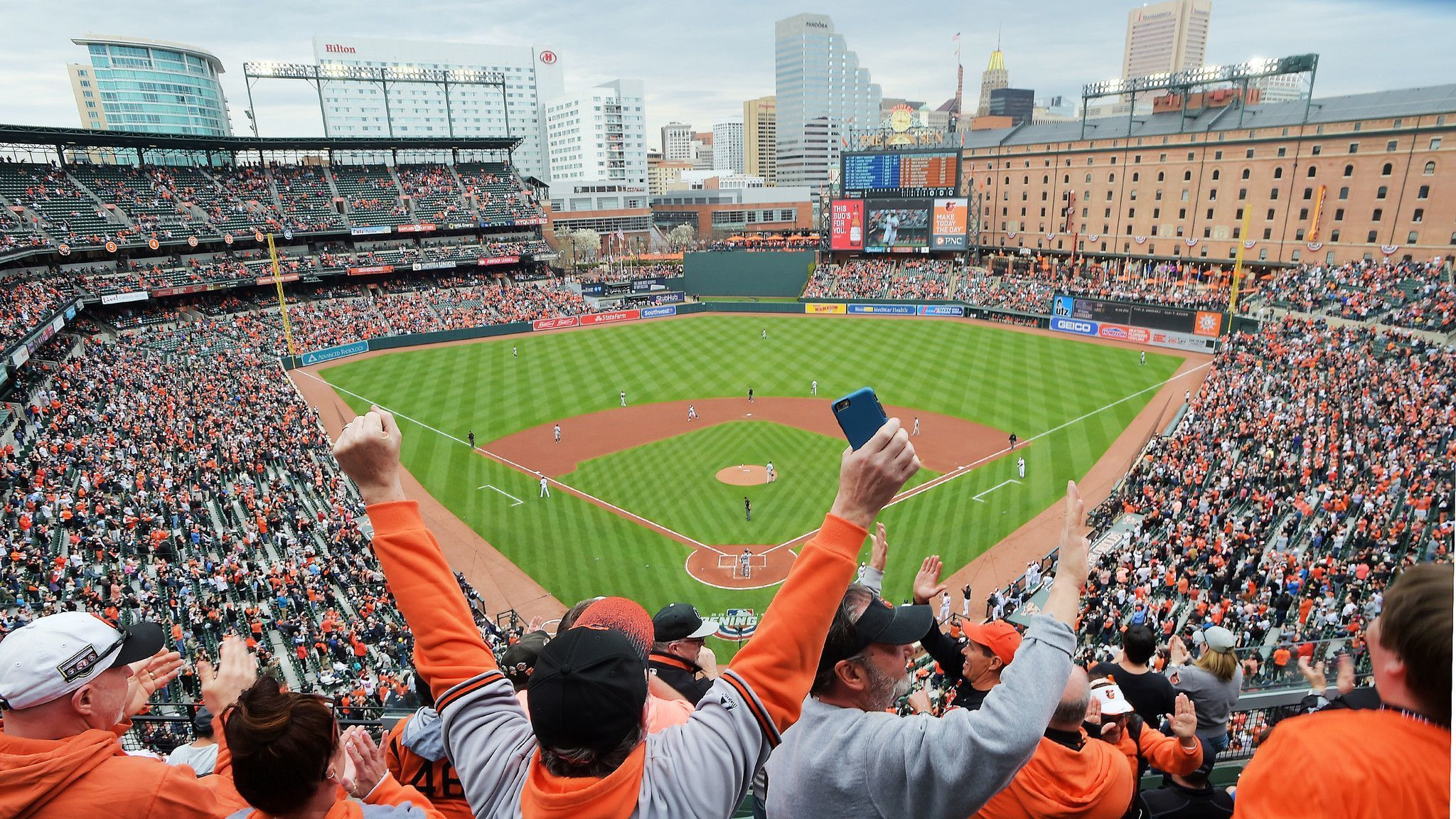Fans celebrate after Oriole Jonathan Villar homered in the first inning of the Baltimore Orioles' ho
