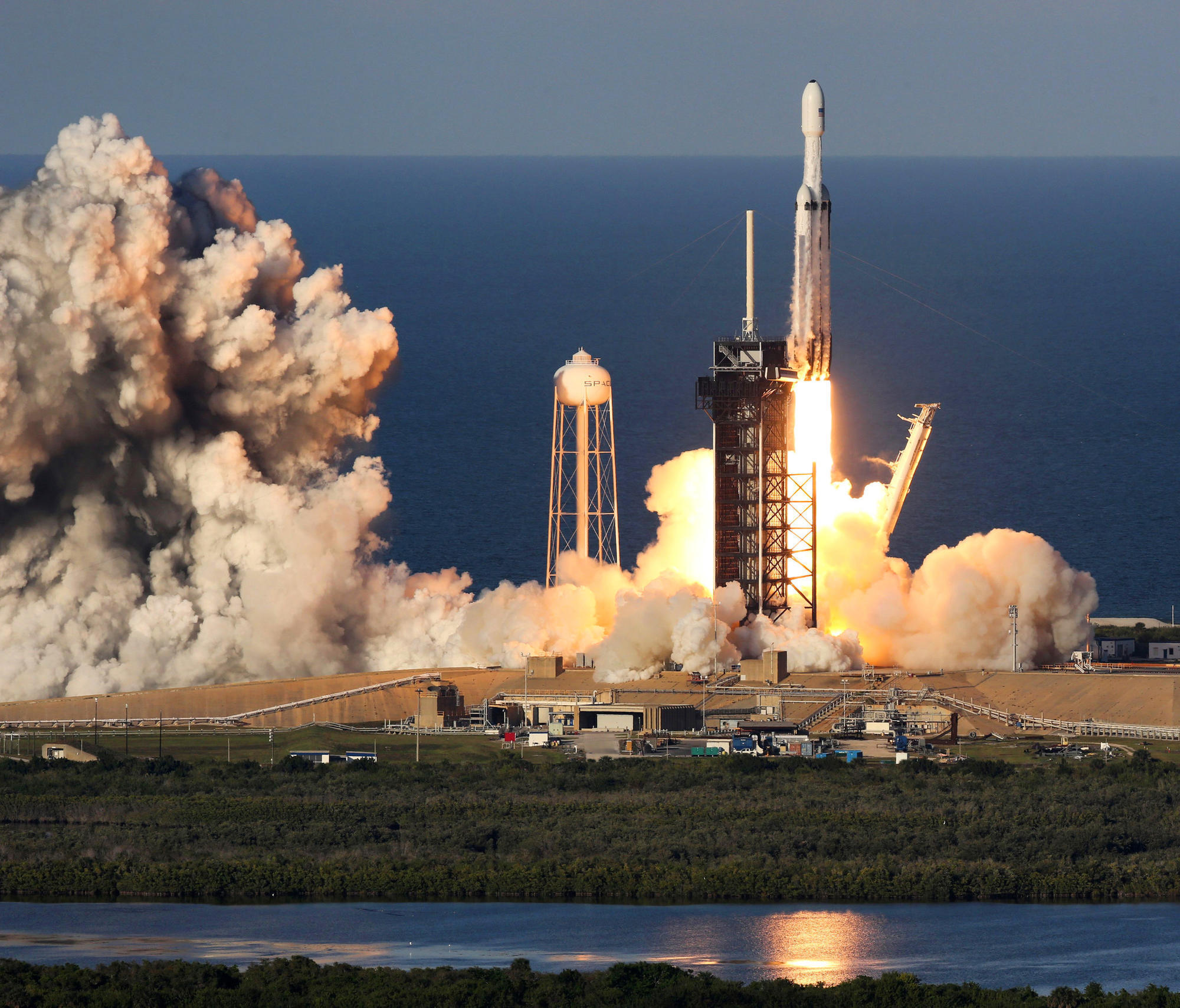 SpaceX launches Falcon Heavy, sticks 3-booster landing ...